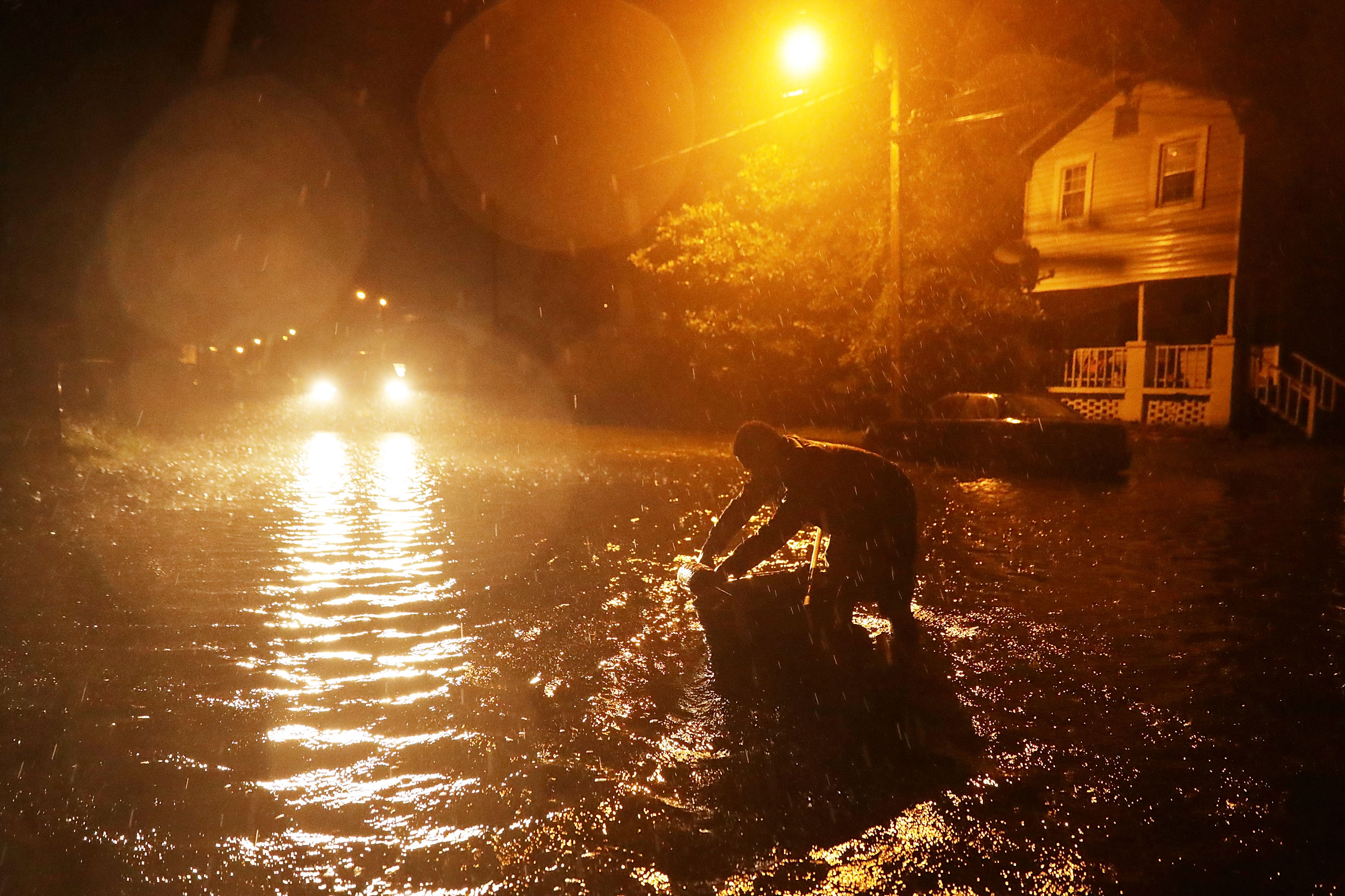 Michael Nelson floats in a boat made from a metal tub and fishing floats after the Neuse River went over its banks and flooded his street during Hurricane Florence September 13, 2018 in New Bern, North Carolina.