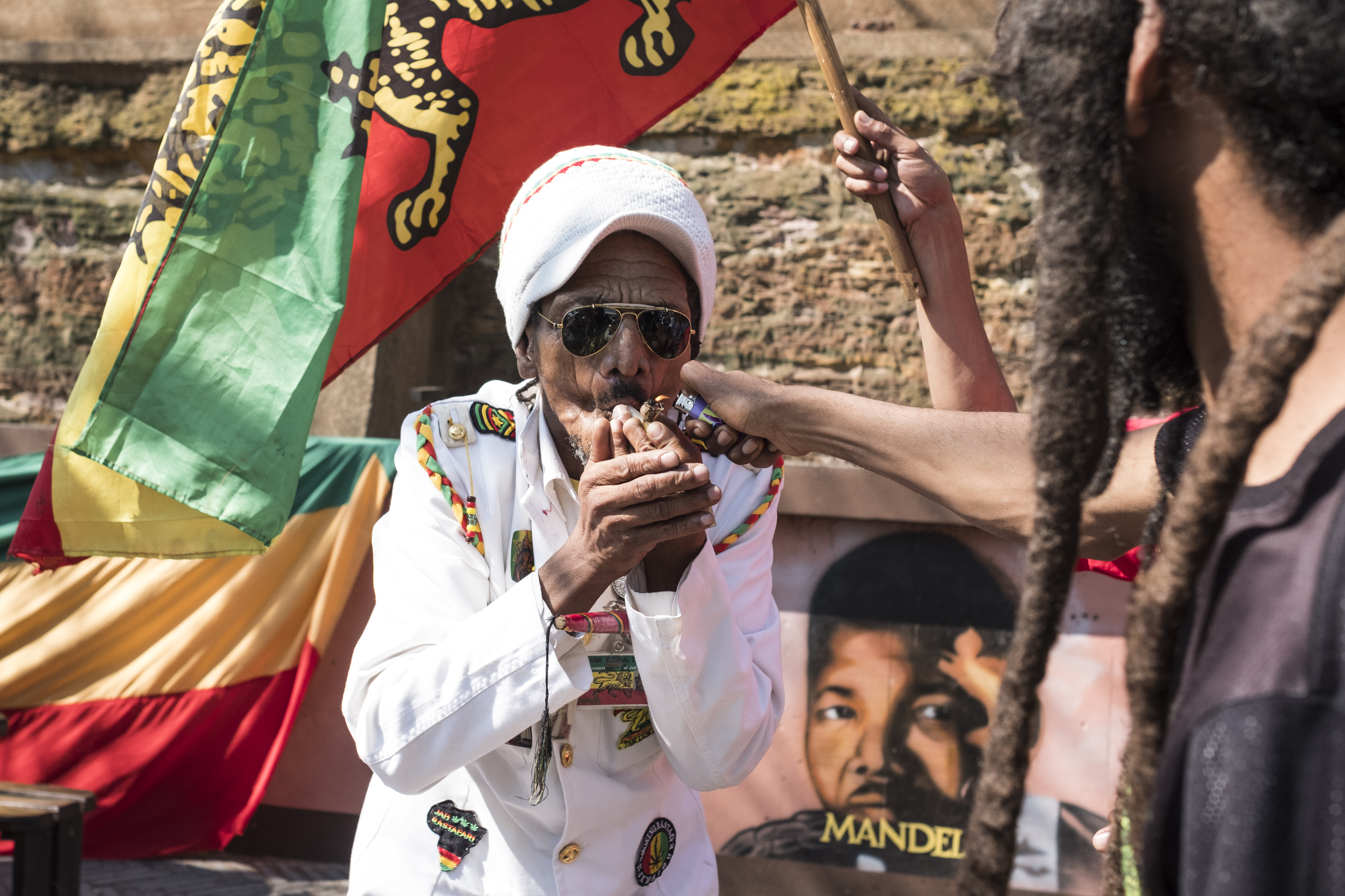A man smokes marijuana outside the Constitutional Court in Johannesburg on Sept. 18, 2018.
