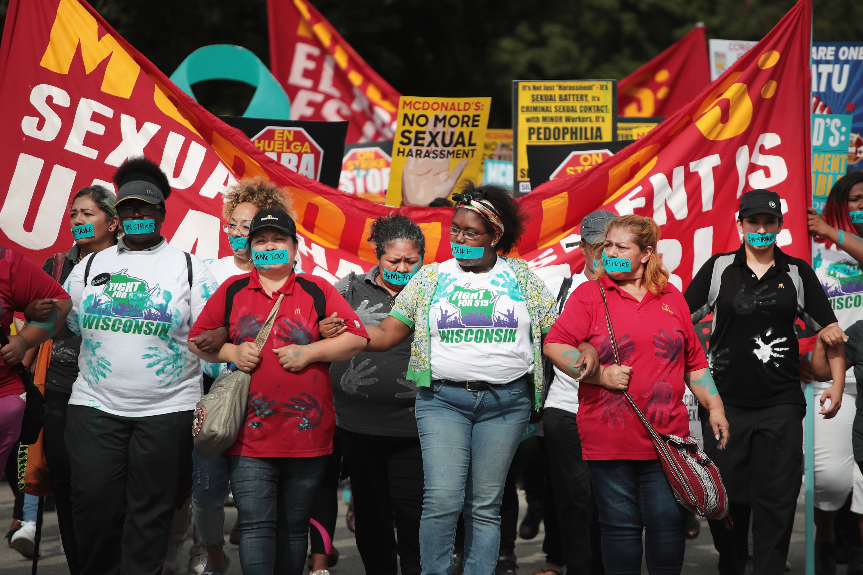 McDonald's workers are joined by other activists as they march toward the company's headquarters to protest sexual harassment at the fast food chain's restaurants in Chicago, Ill. on Sept. 18, 2018.