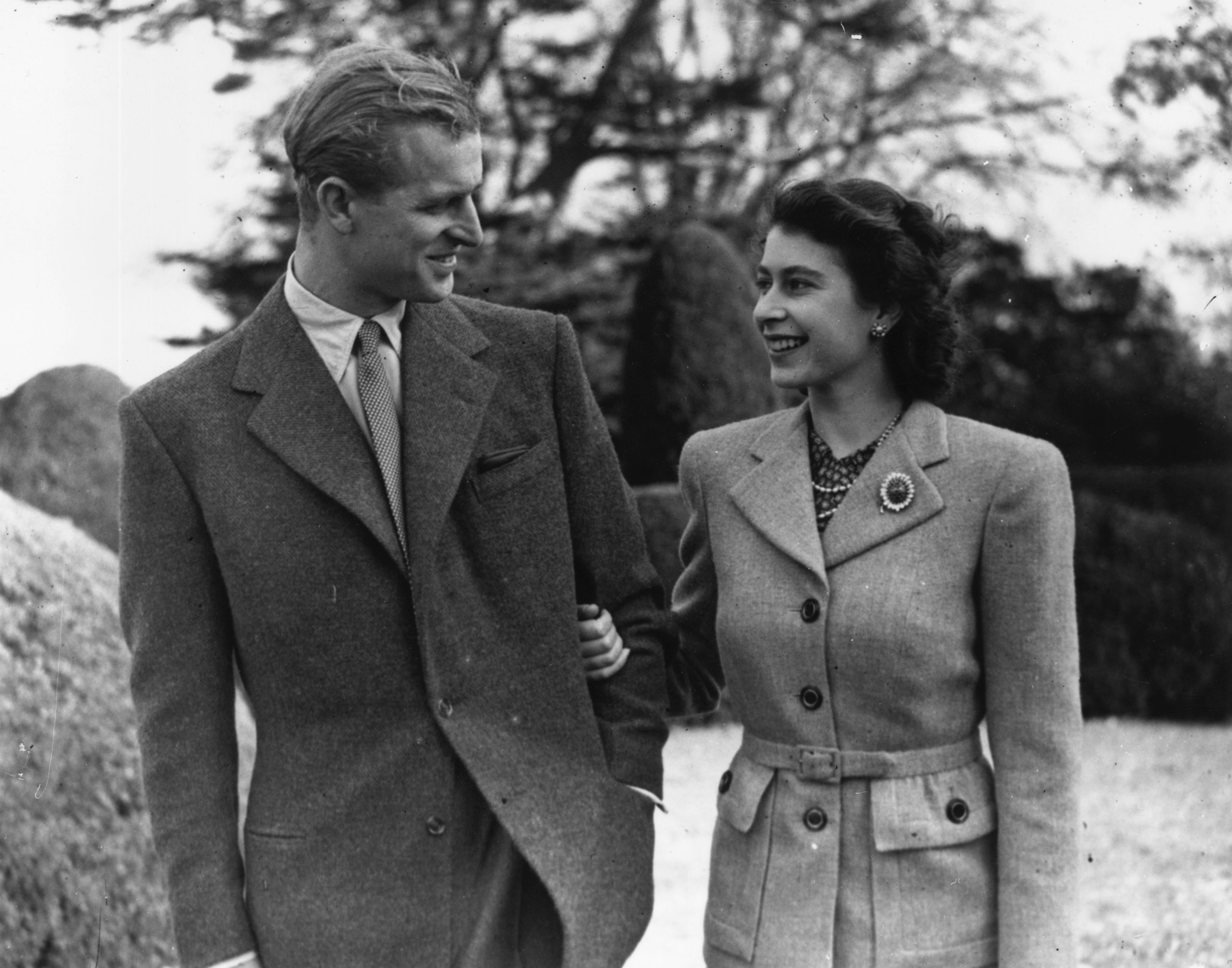 Princess Elizabeth and Philip Mountbatten, Duke of Edinburgh, walk during their honeymoon at Broadlands, Romsey, Hampshire, Nov. 24, 1947.