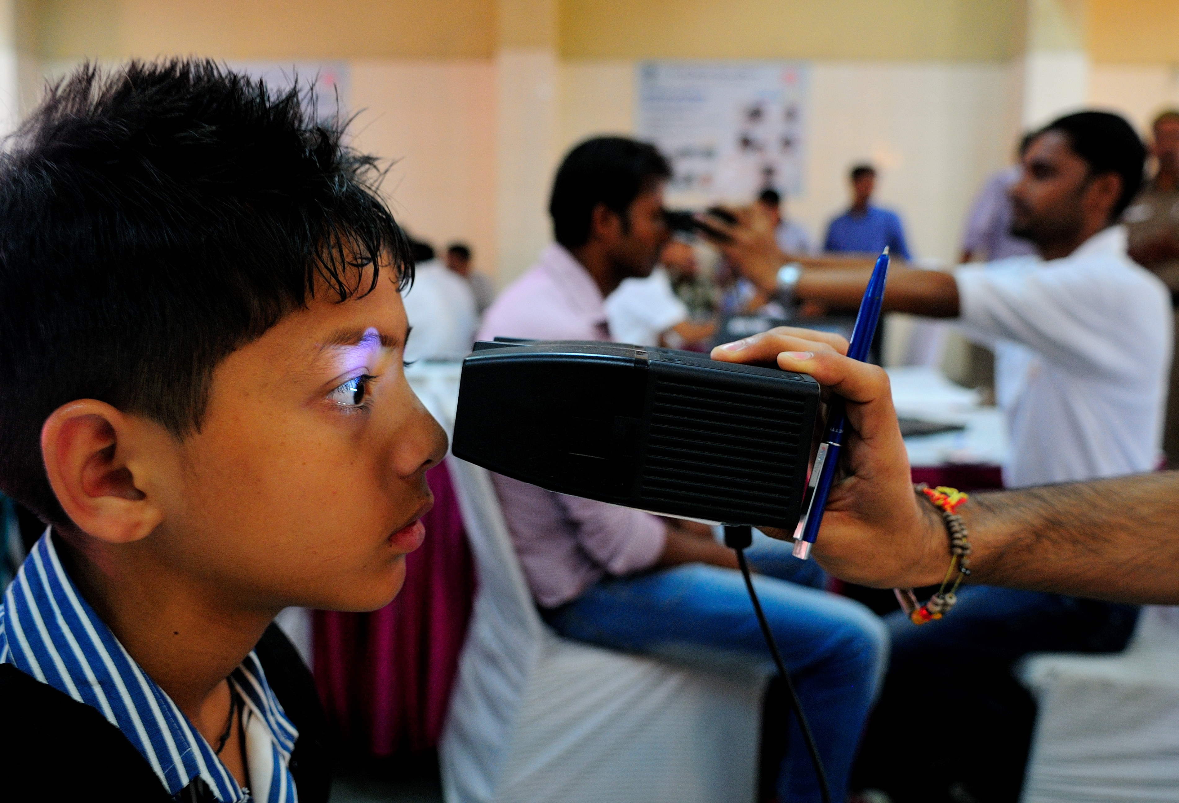 APRIL 12, 2013: A young boy has his iris scanned for an Aadhaar card, New Delhi