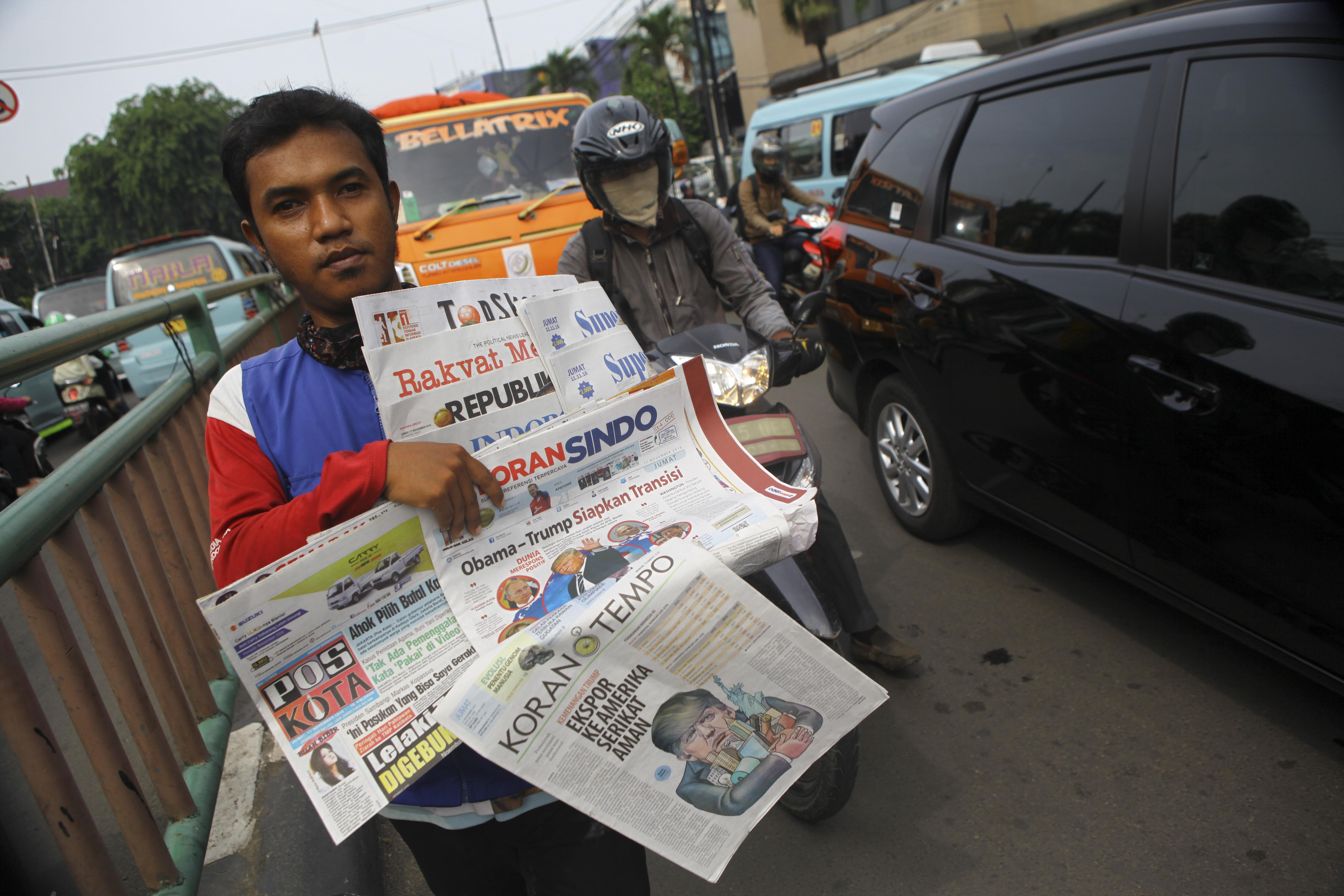 A newspaper vendor in Jakarta, indonesia on Nov. 11, 2016.