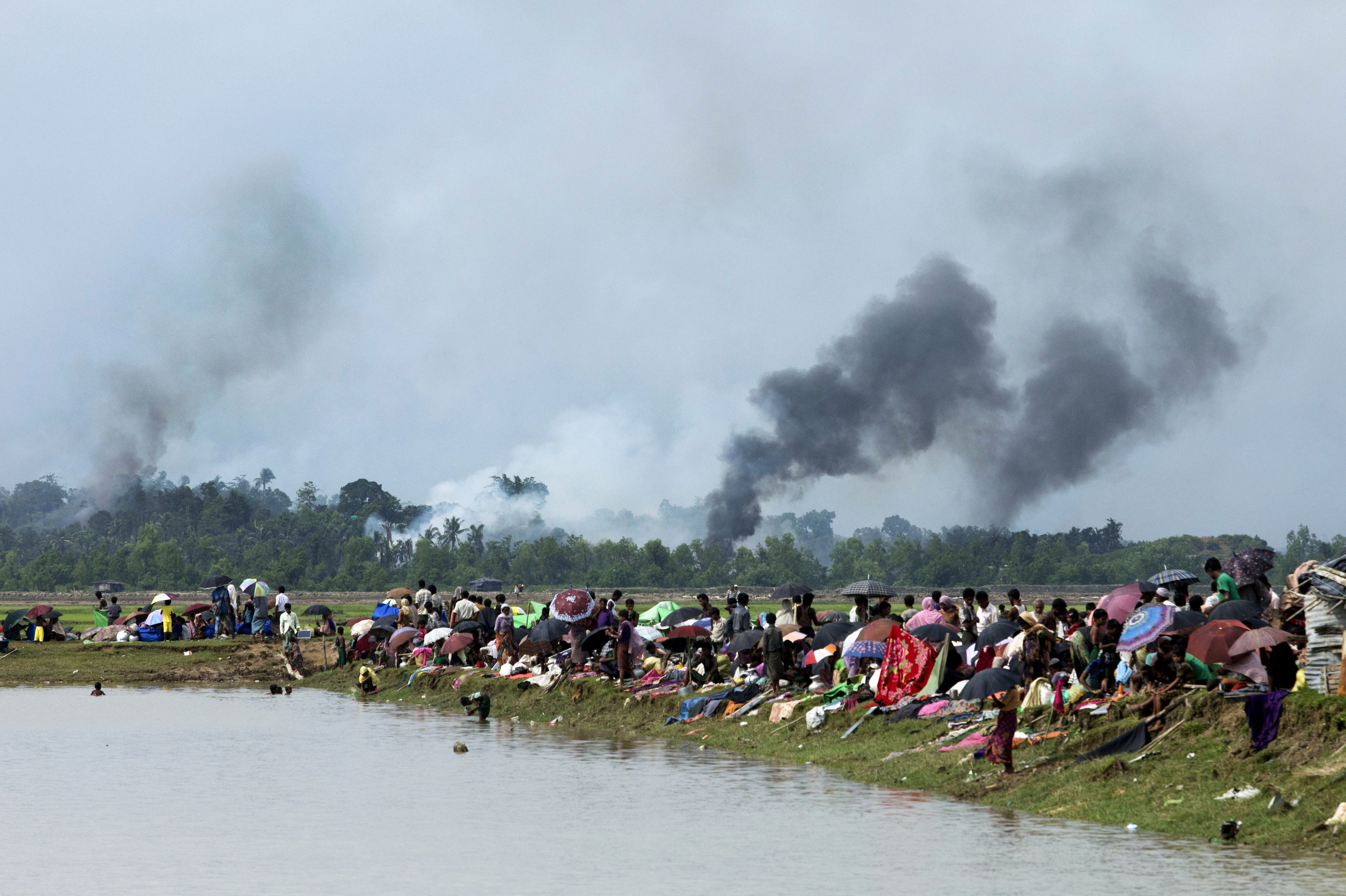 Smoke billows above what is believed to be a burning village in Myanmar's Rakhine state as members of the Rohingya Muslim minority take shelter in Ukhia, Bangladesh on Sept. 4, 2017.