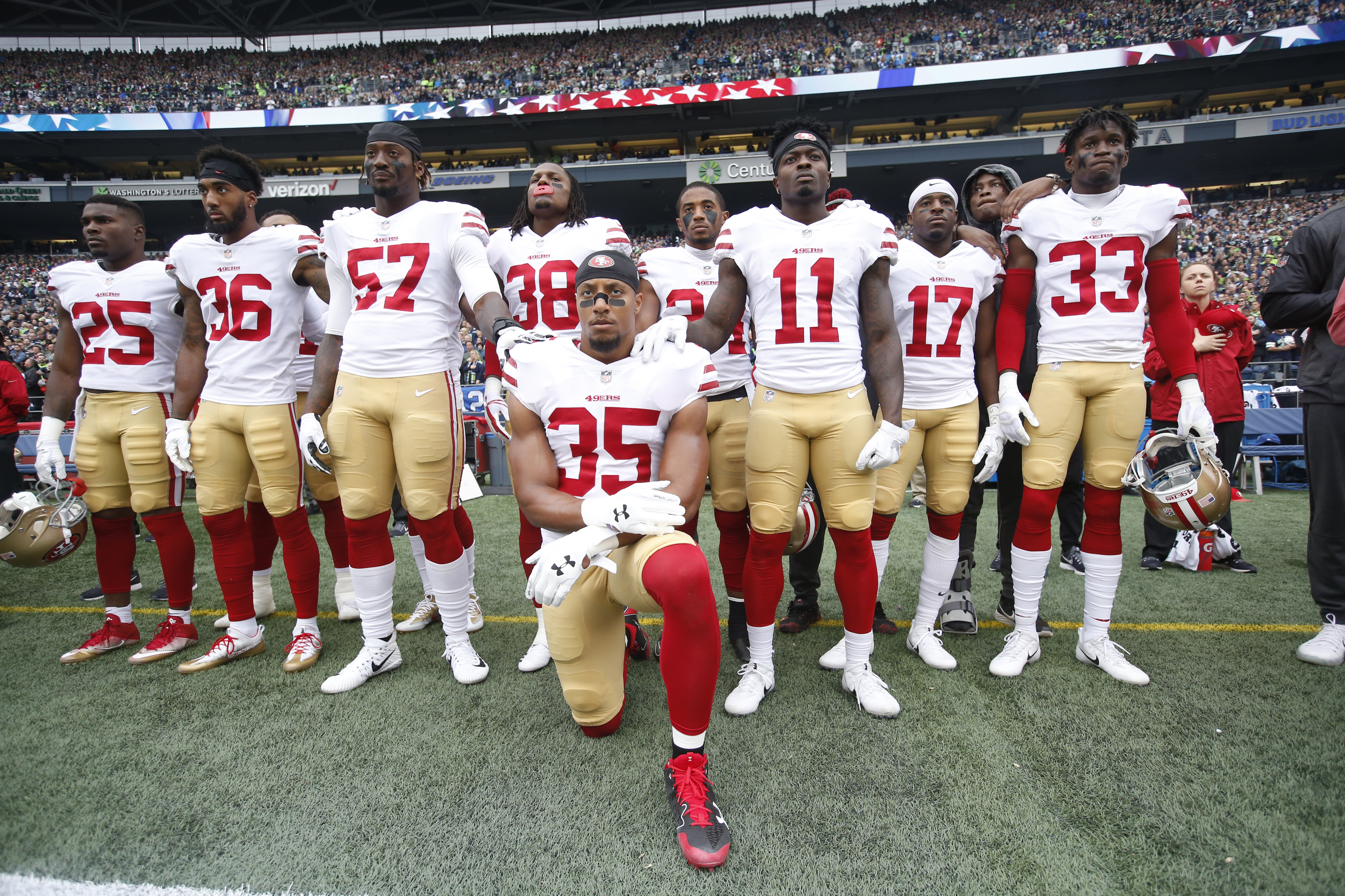 Eric Reid #35 of the San Francisco 49ers kneels during the anthem with the support of teammates prior to the game against the Seattle Seahawks at CenturyLink Field on September 17, 2017 in Seattle, Washington.
