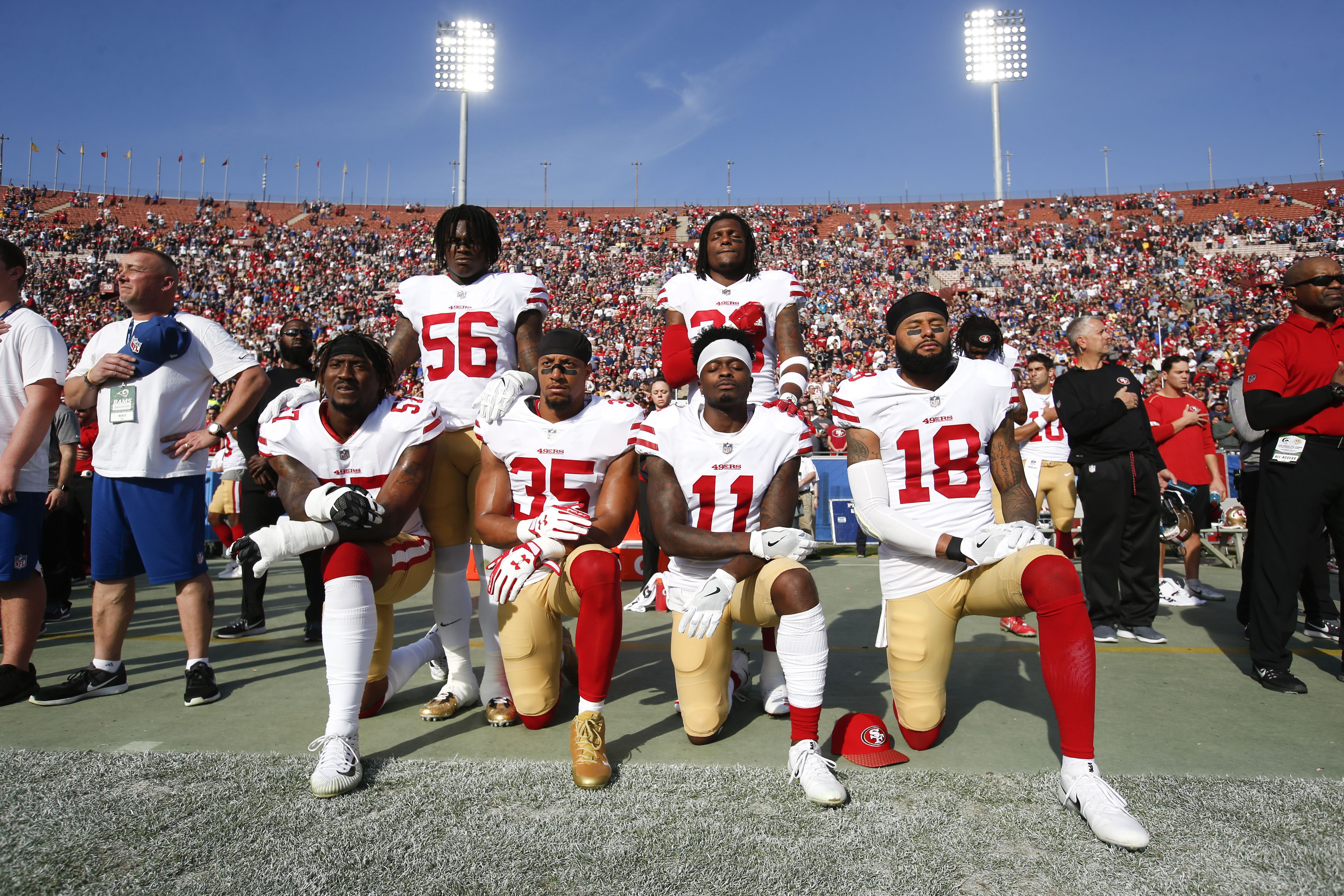 DEC. 31 2017: San Francisco 49ers players kneel during the national anthem