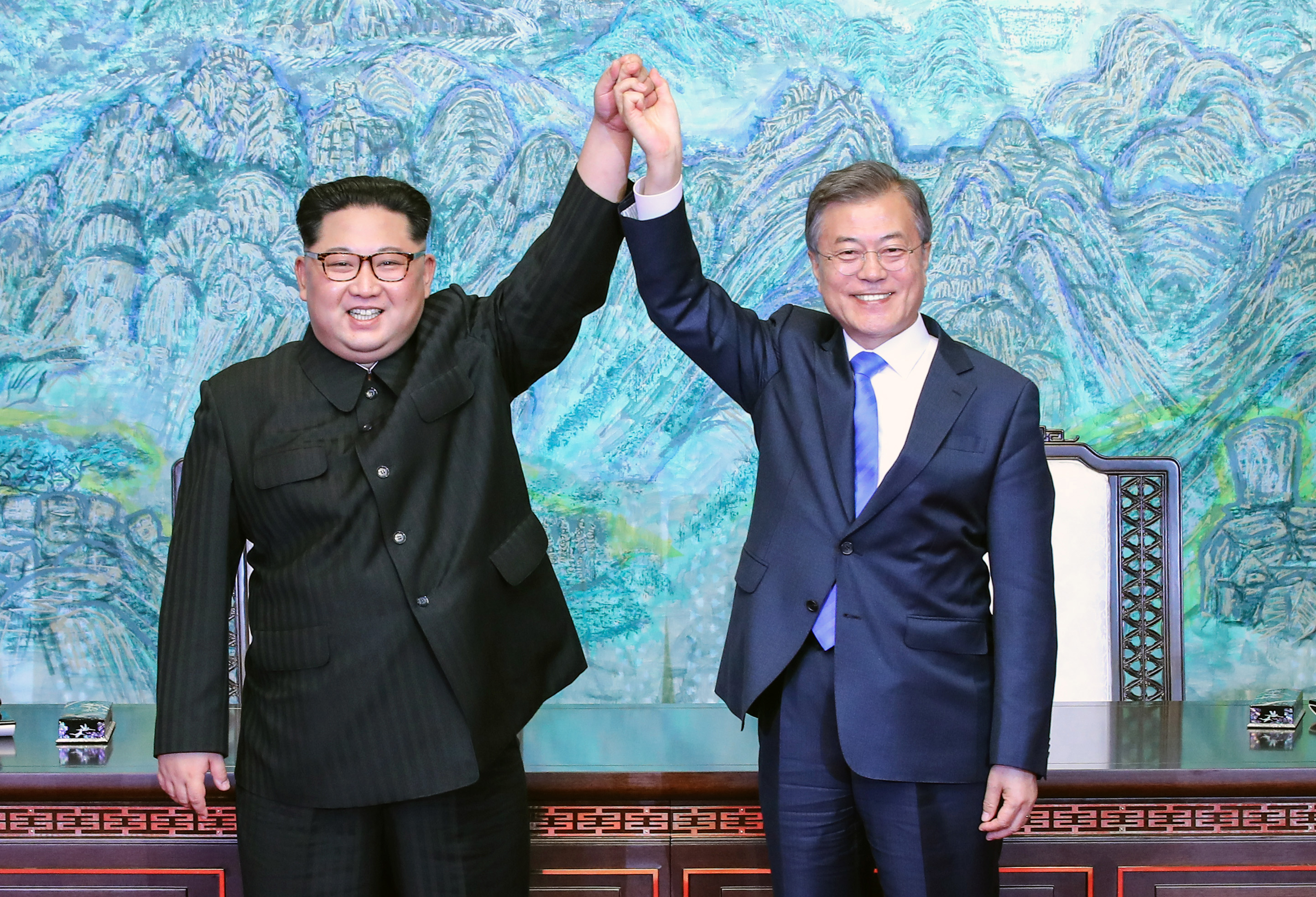 North Korean leader Kim Jong Un (L) and South Korean President Moon Jae-in (R) pose for photographs after signing the Panmunjom Declaration for Peace, Prosperity and Unification of the Korean Peninsula during the Inter-Korean Summit on April 27, 2018.