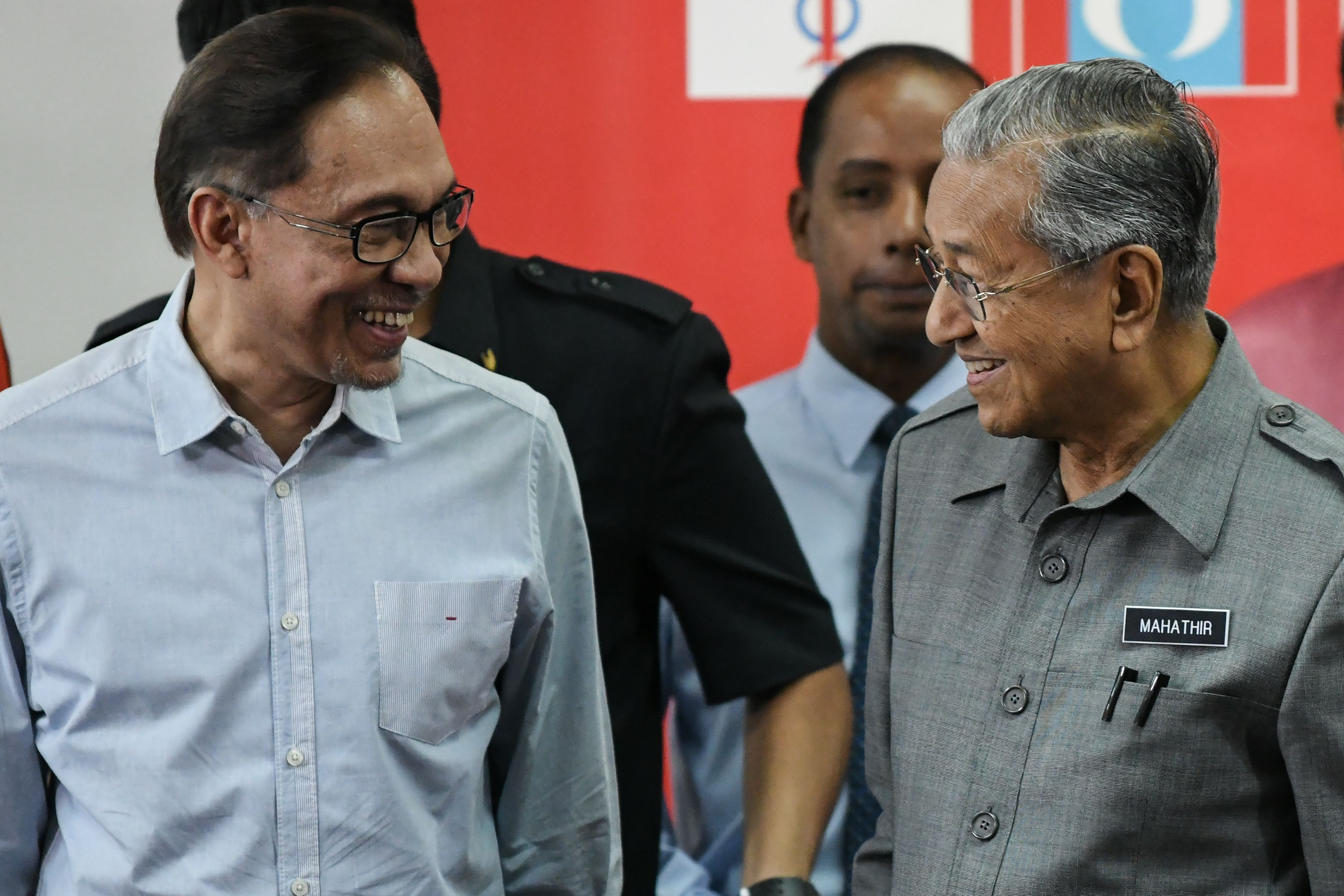 Malaysia's Prime Minister Mahathir Mohamad (R) and politician Anwar Ibrahim, leave after a press conference in Kuala Lumpur on June 1, 2018.
