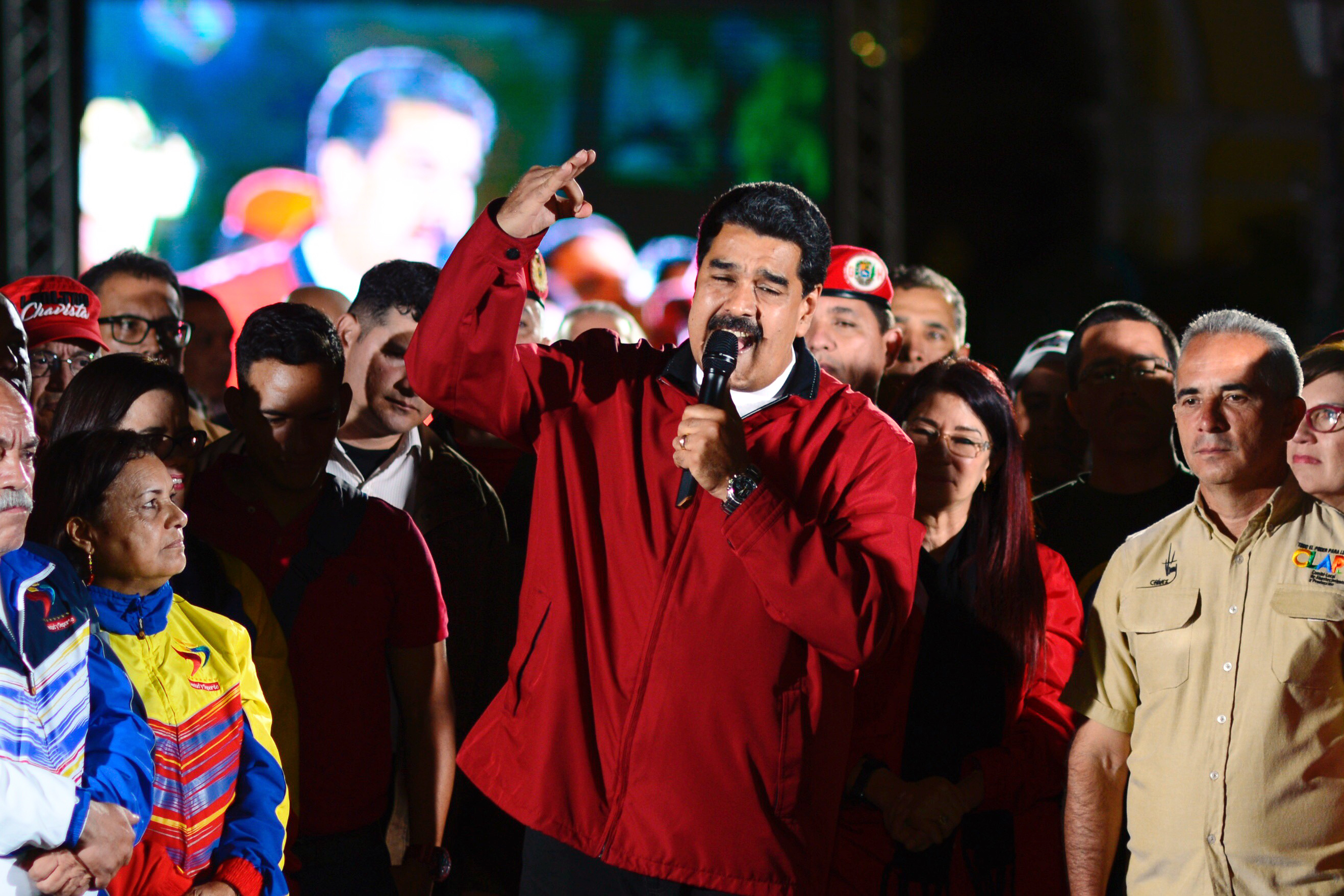 The Venezuelan President Nicolás Maduro (C) speaks next electoral candidates after the first results of the controversial election for a constituent assembly on the Bolivar square in Caracas, Venezuela, 31 July 2017.