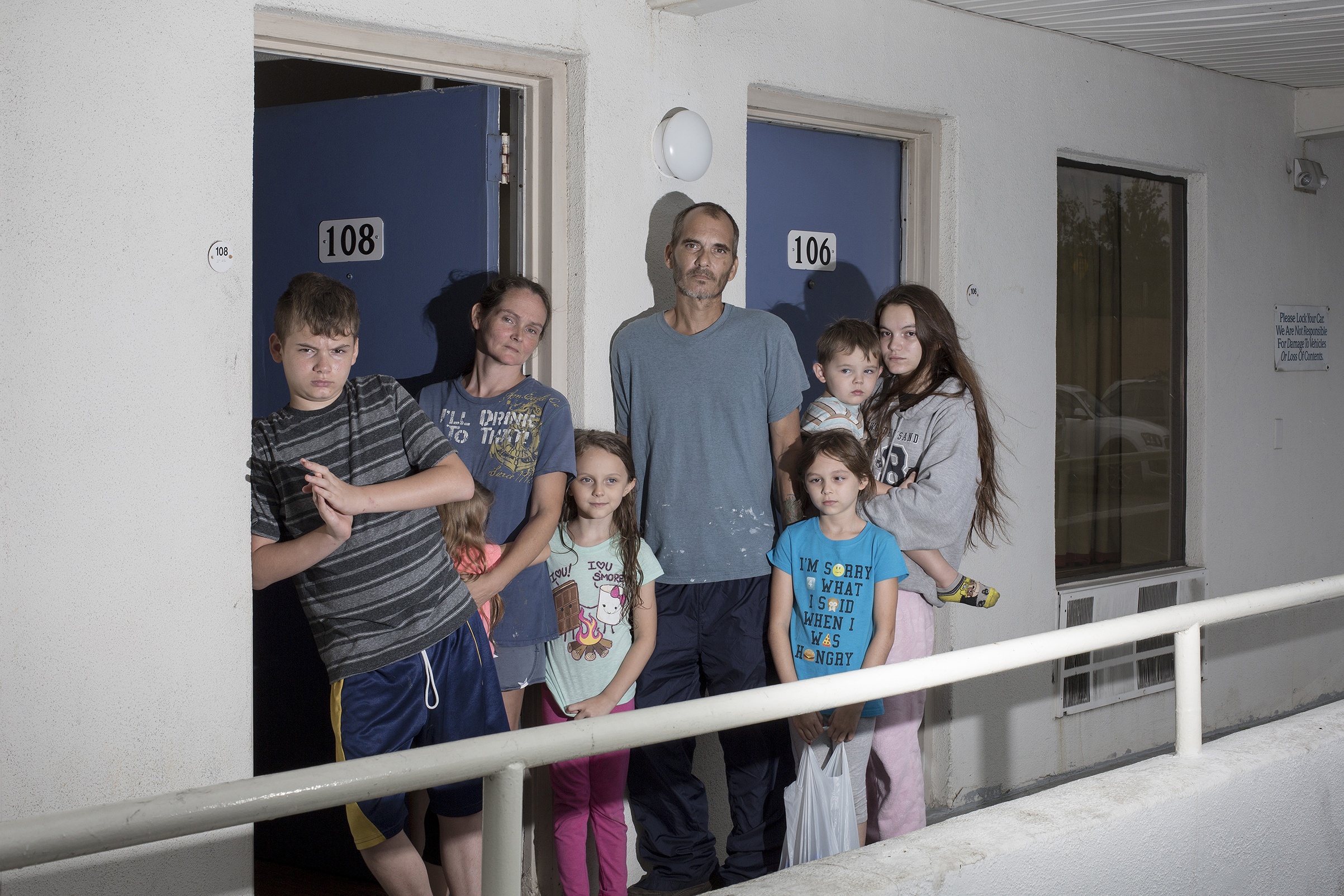The Brown family from Jacksonville, N.C., poses for a portrait at a motel after fleeing Hurricane Florence in Cary, N.C. on Sept. 14.