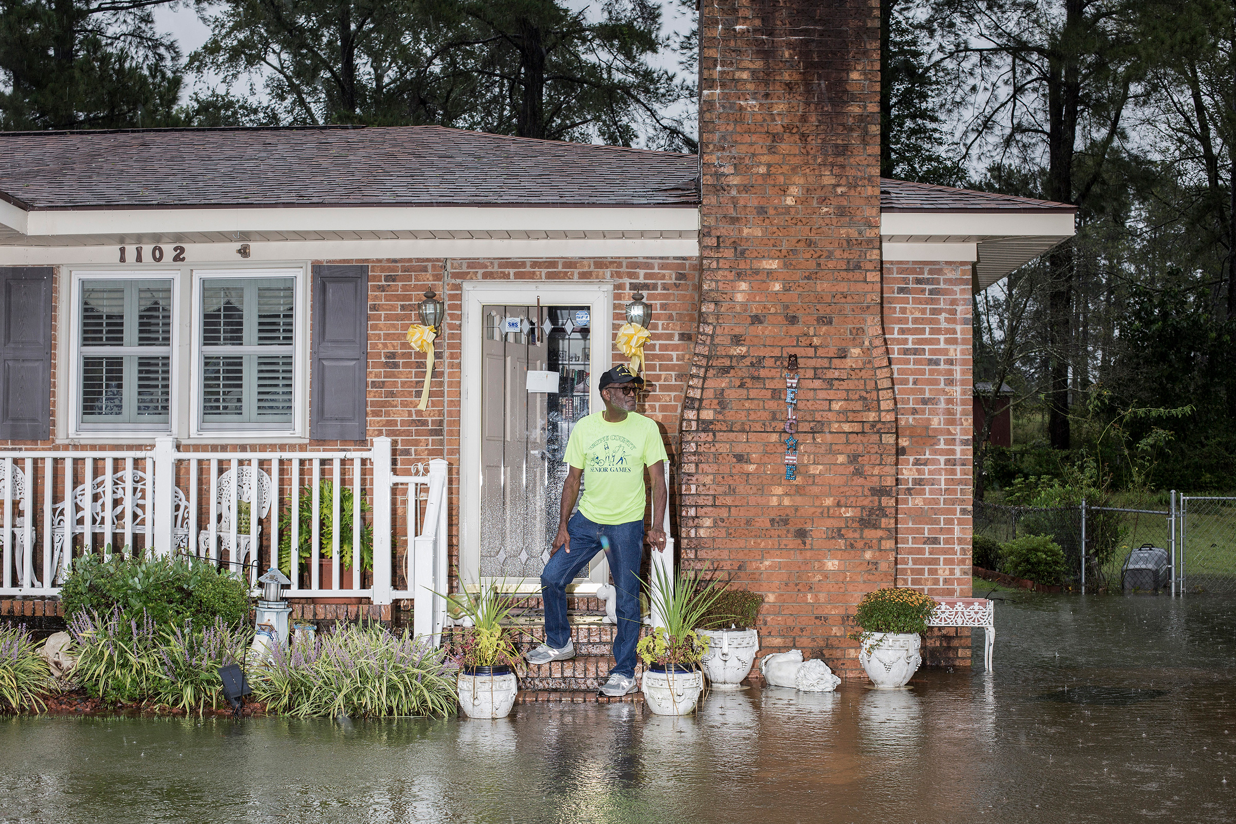 Coy Coley in front of his home in Goldsboro, N.C., after his neighborhood was flooded due to rainfall from Hurricane Florence on Sept. 15.