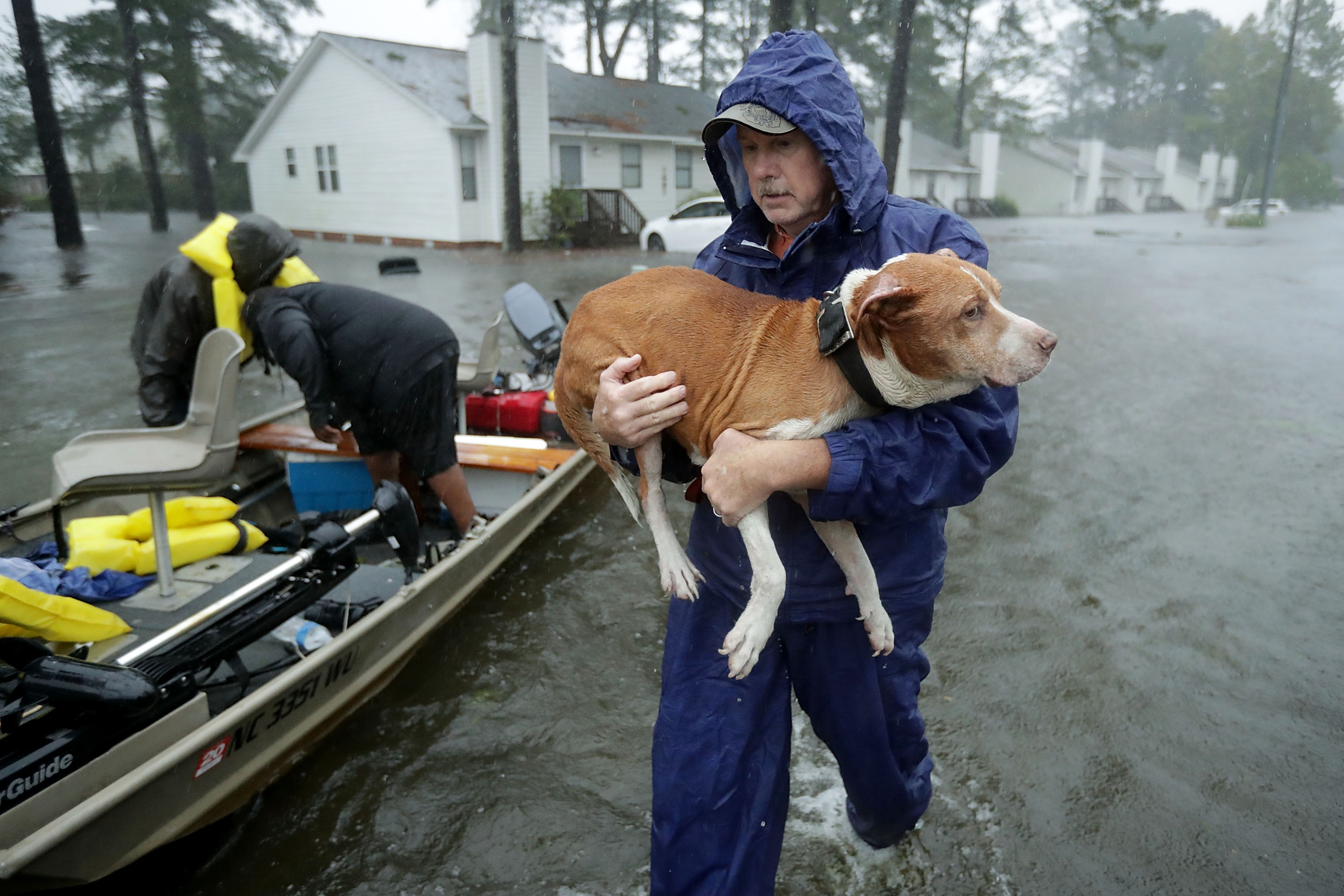 Volunteers from all over North Carolina help rescue residents and their pets from their flooded homes during Hurricane Florence September 14, 2018 in New Bern, North Carolina.