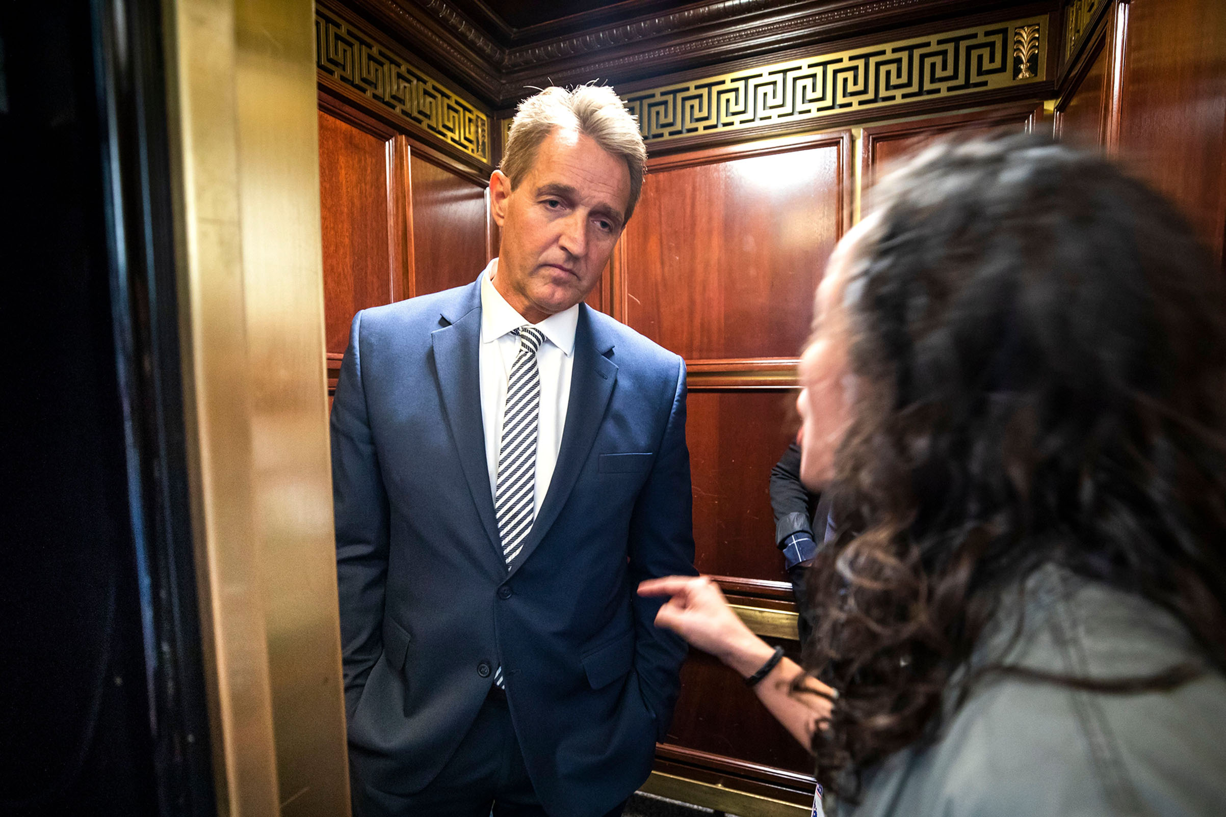 A woman who said she is a survivor of a sexual assault confronts Republican Senator from Arizona Jeff Flake in an elevator after Flake announced that he vote to confirm Supreme Court nominee Brett Kavanaugh on Sept. 28, 2018.