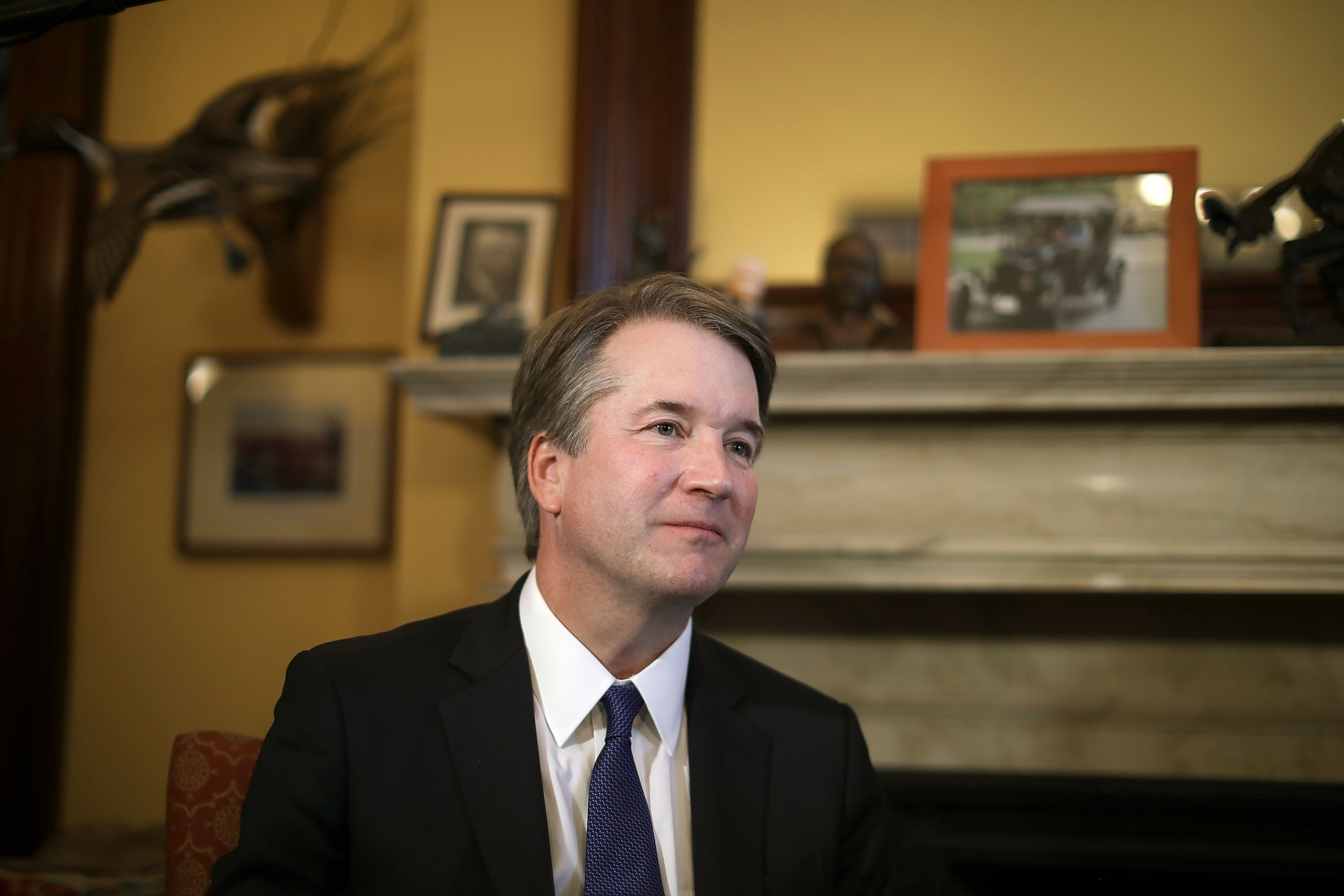 Judge Brett Kavanaugh listens to Sen. Rob Portman (R-OH) talk about Kavanaugh's qualifications before a meeting in the Russell Senate Office Building on Capitol Hill July 11, 2018 in Washington, DC.