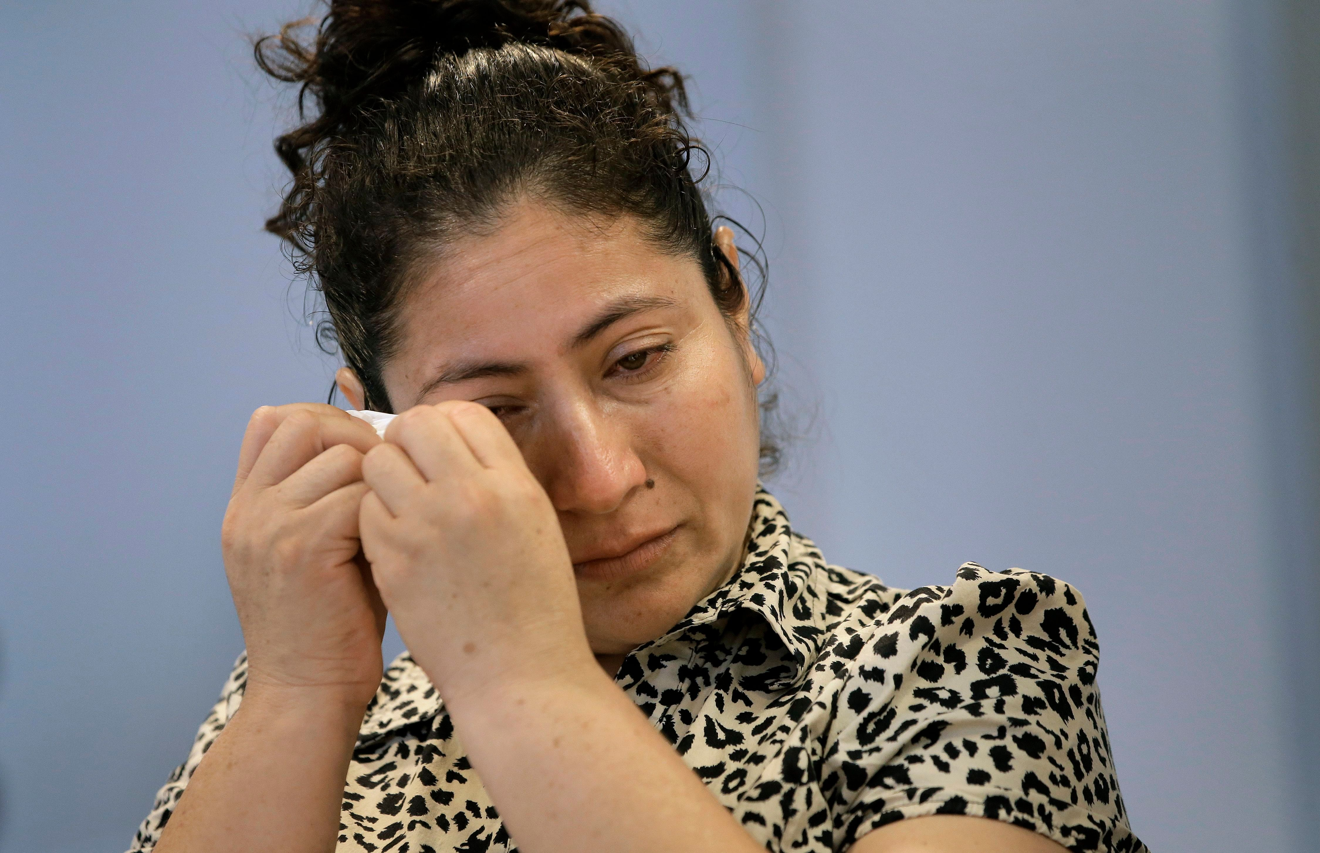 A mother from Guatemala, identified only by initials L.J., who was separated from her two children after entering the U.S. in May of 2018, is tearful while speaking to reporters about the separation during a news conference in Boston on Sept. 6, 2018.