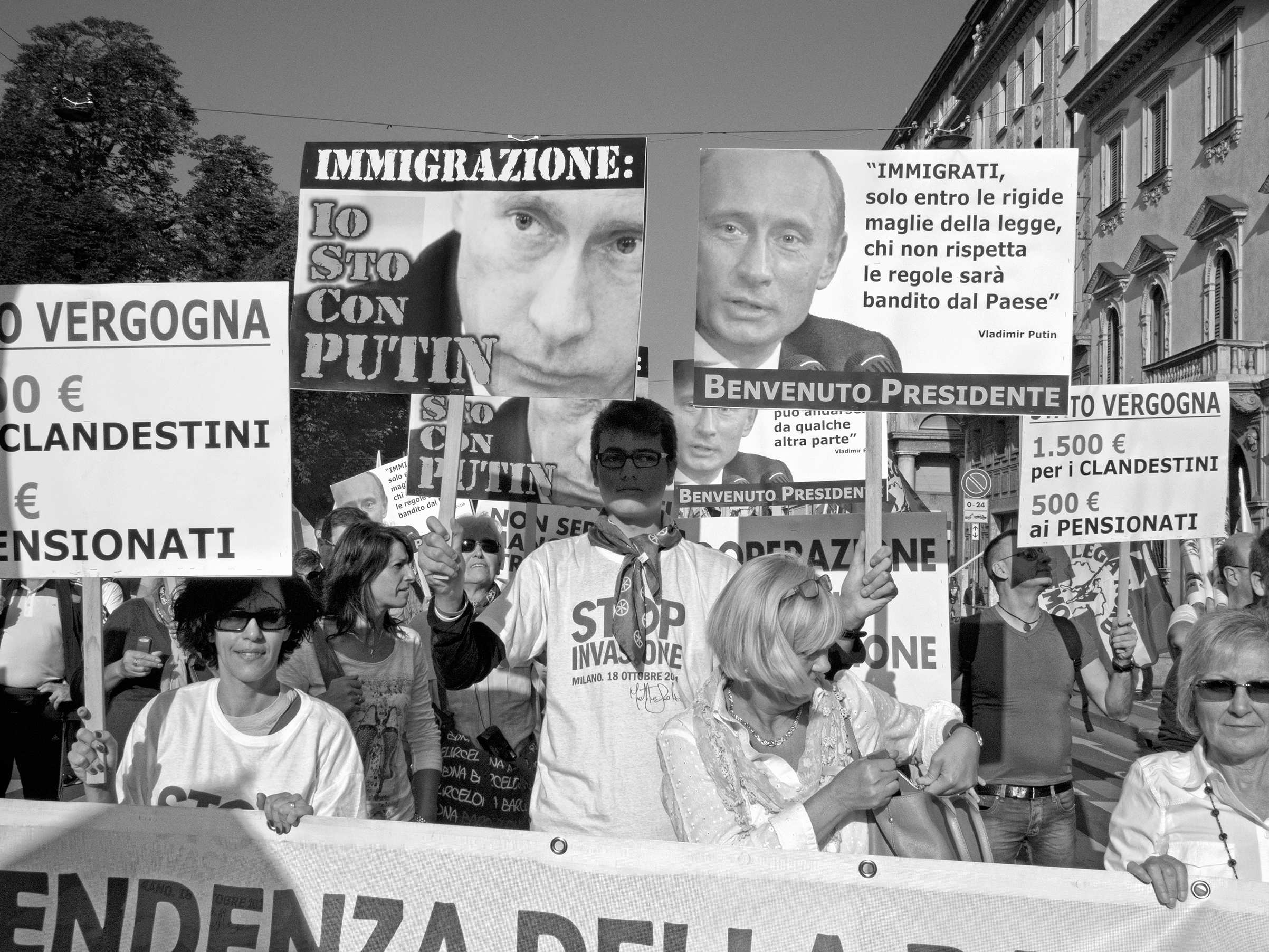 """Supporters of the then Northern League rally against an immigrant """"invasion"""" in Milan in October 2014"""