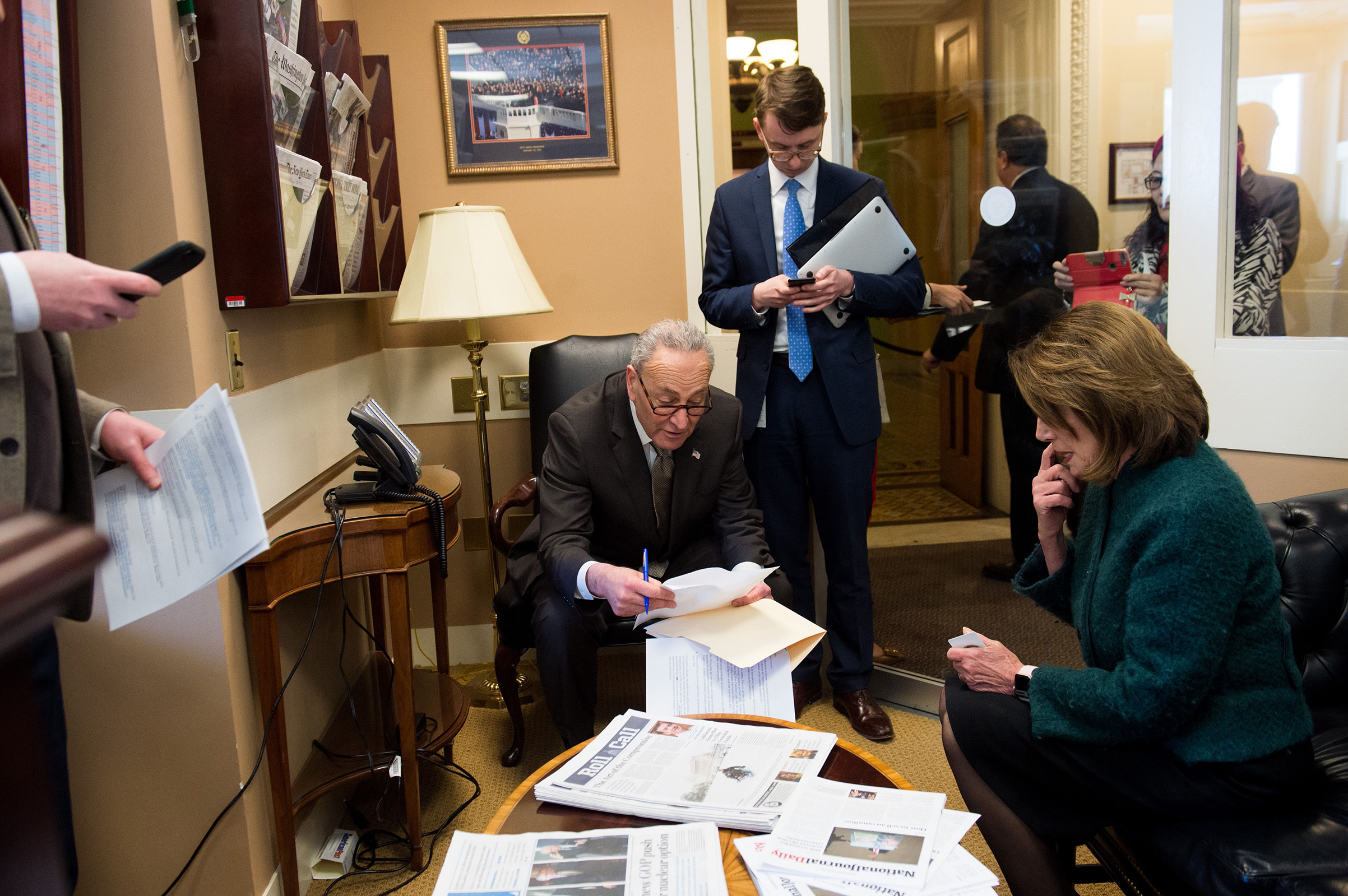 Pelosi and Senate Democratic leader Chuck Schumer huddle in the Capitol in March