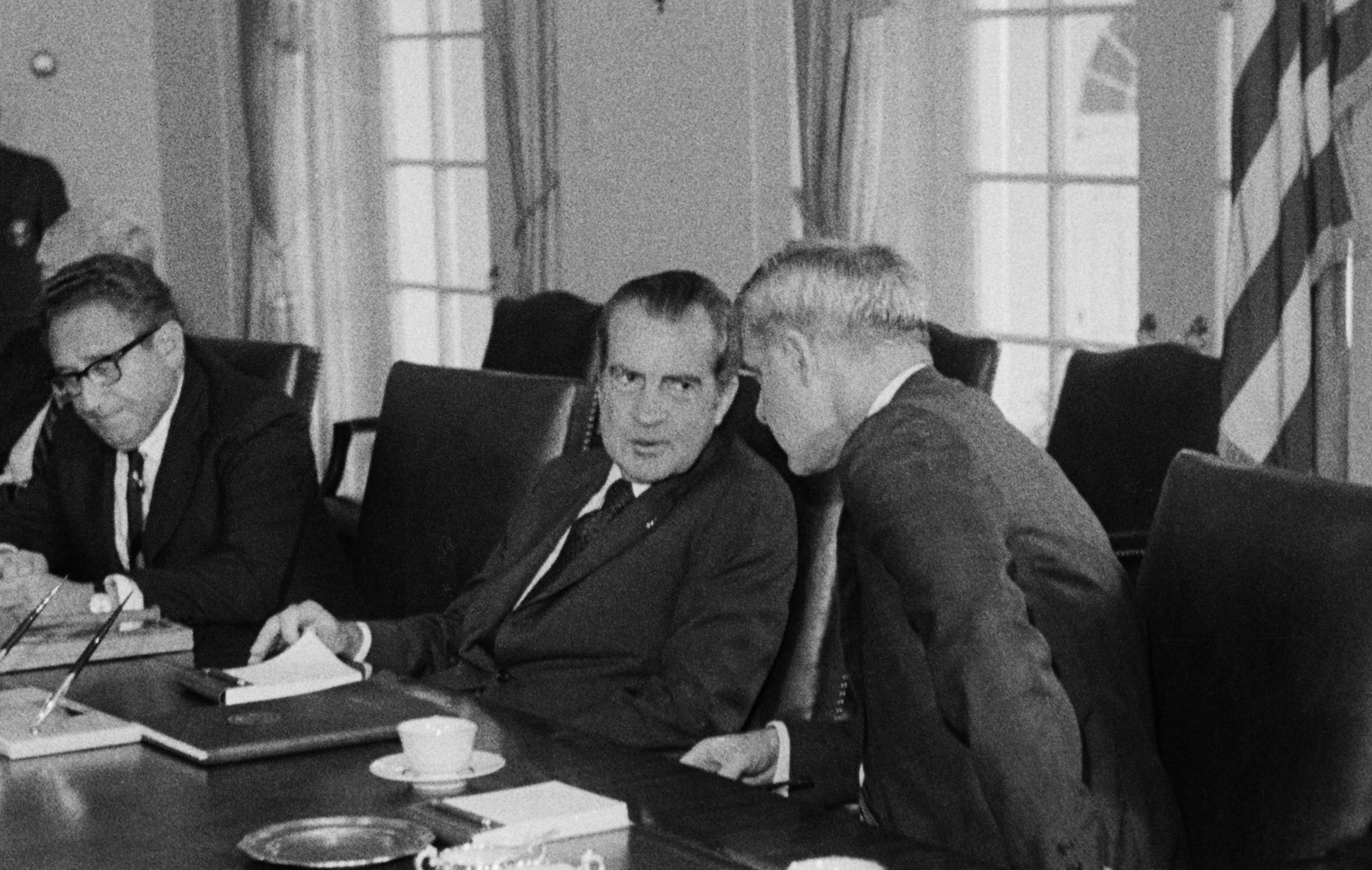 Nixon flanked by Secretary of State Henry Kissinger (left) and Secretary of Defense James Schlesinger at the White House on Aug. 6, 1974.
