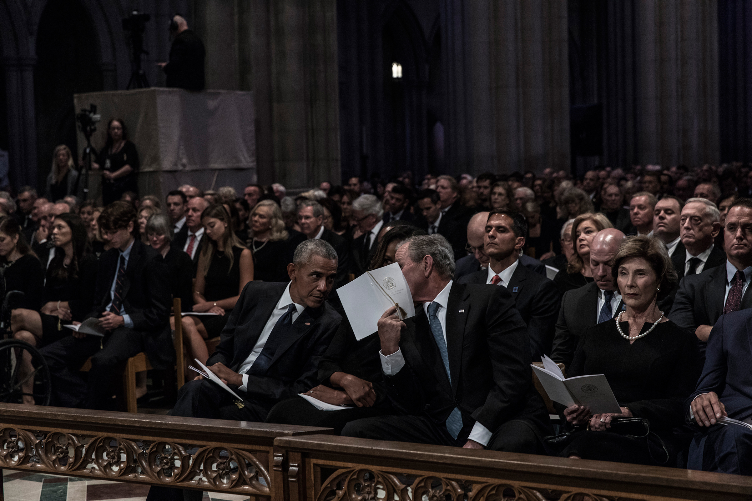 Former US President Barack Obama, Michelle Obama, former President George W. Bush and Laura Bush during a memorial service for Senator John McCain at the Washington National Cathedral on September 1, 2018.