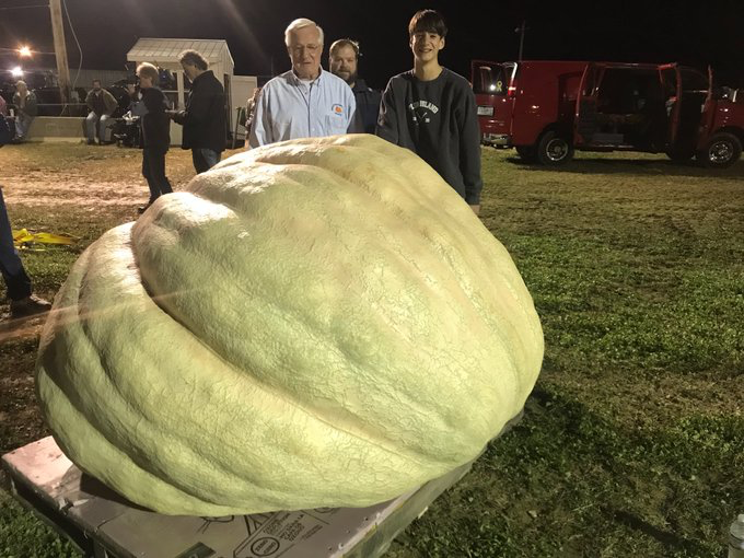 Steve Geddes shows off his record-breaking pumpkin