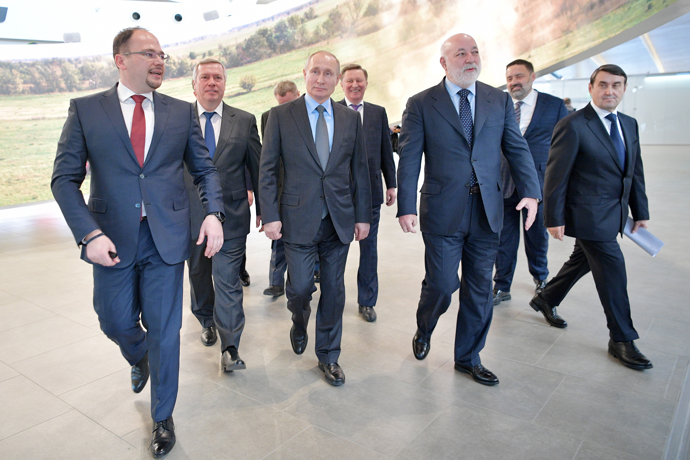 Putin at Platon International Airport in February with tycoon Vekselberg, center right