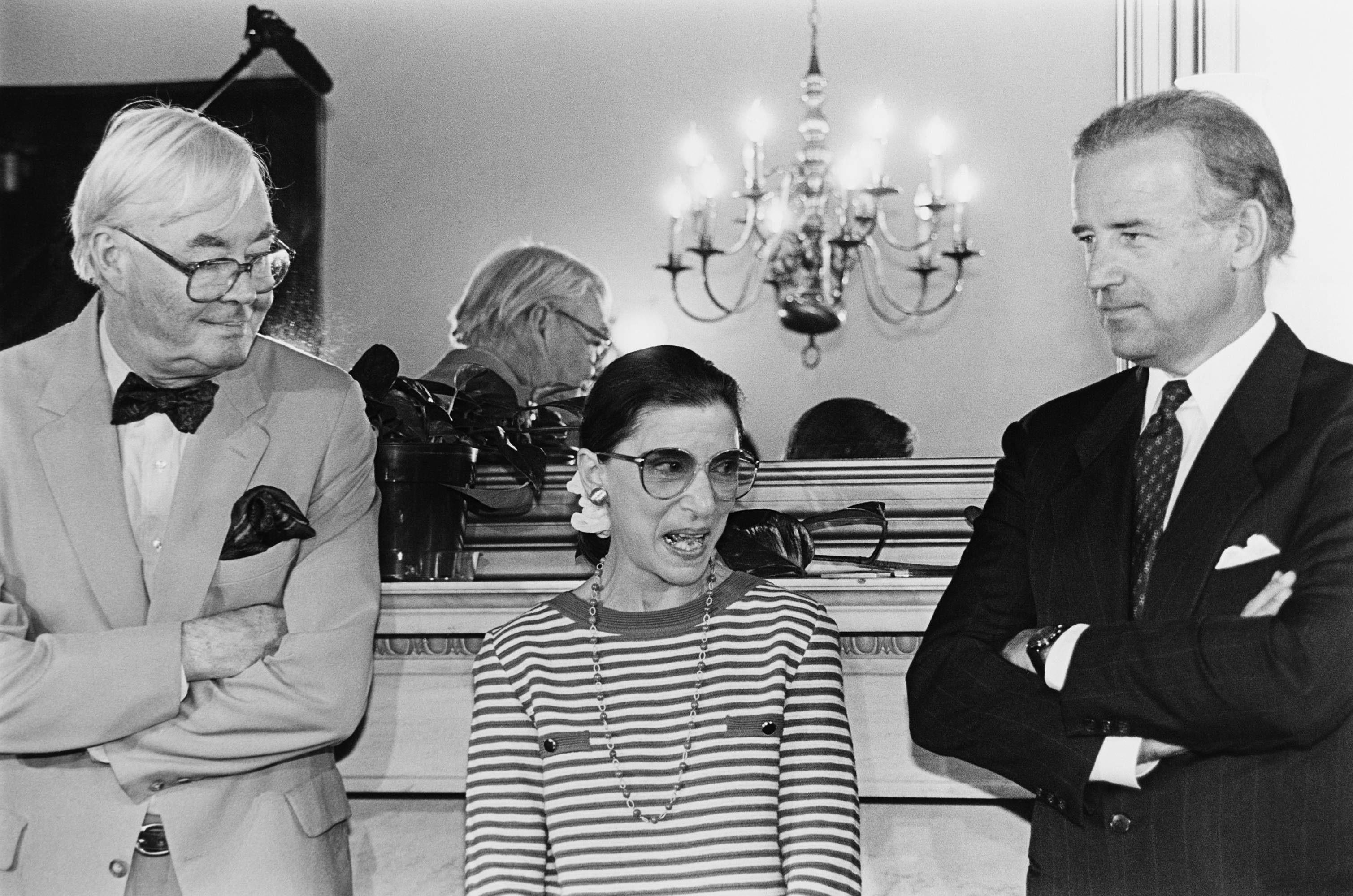Supreme Court nominee Ruth Bader Ginsburg answering reporter's questions during courtesy call to Senator Joe Biden's office. She's standing with Sens. Biden and Daniel Patrick Moynihan, D-N.Y. June 15, 1993