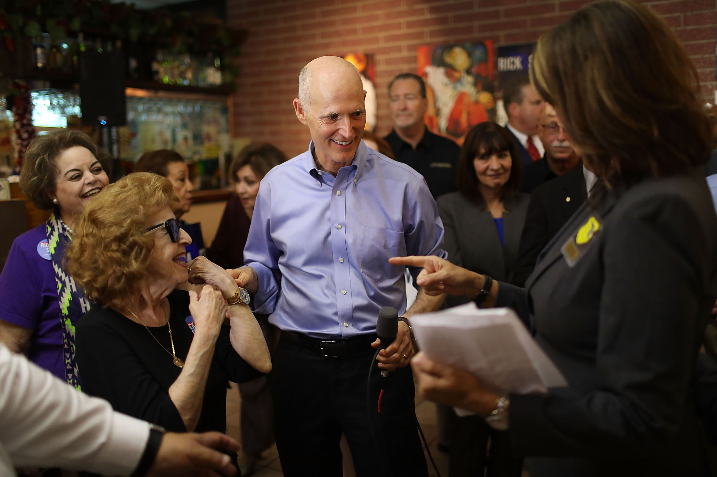 Scott greets voters on June 14 during a campaign stop at Chico's Restaurant in Hialeah, Fla.
