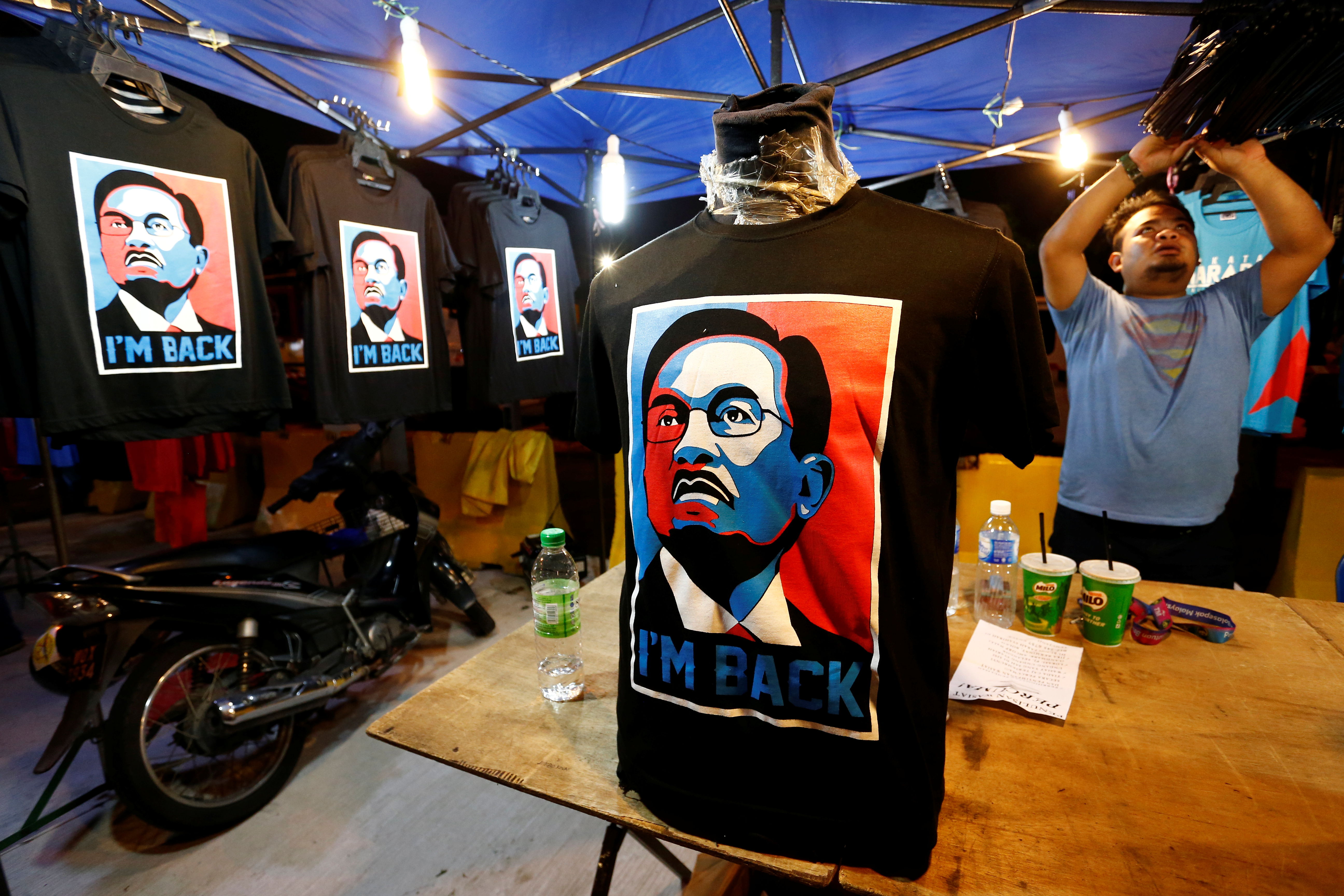 T-shirts depicting Anwar Ibrahim are displayed at a rally in Kuala Lumpur, Malaysia on May 16, 2018.