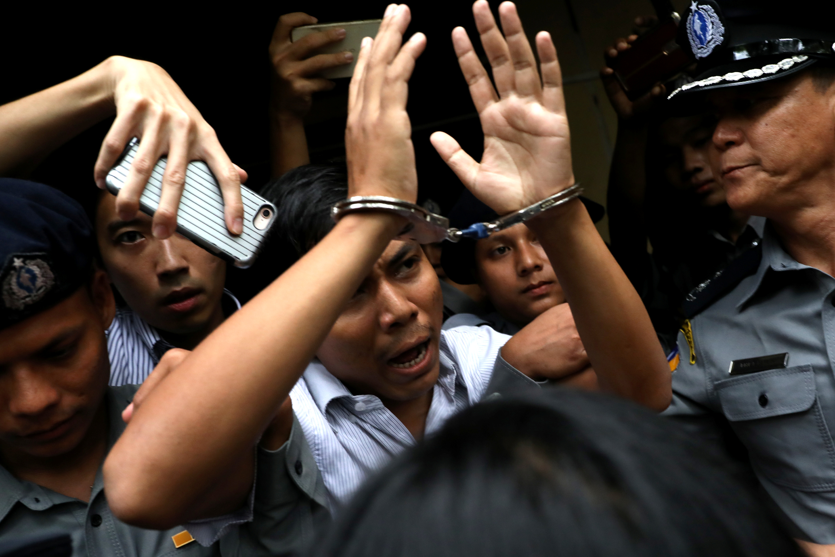 ournalist Kyaw Soe Oo is escorted from court after his verdict in Yangon, Myanmar on Sept. 3, 2018.