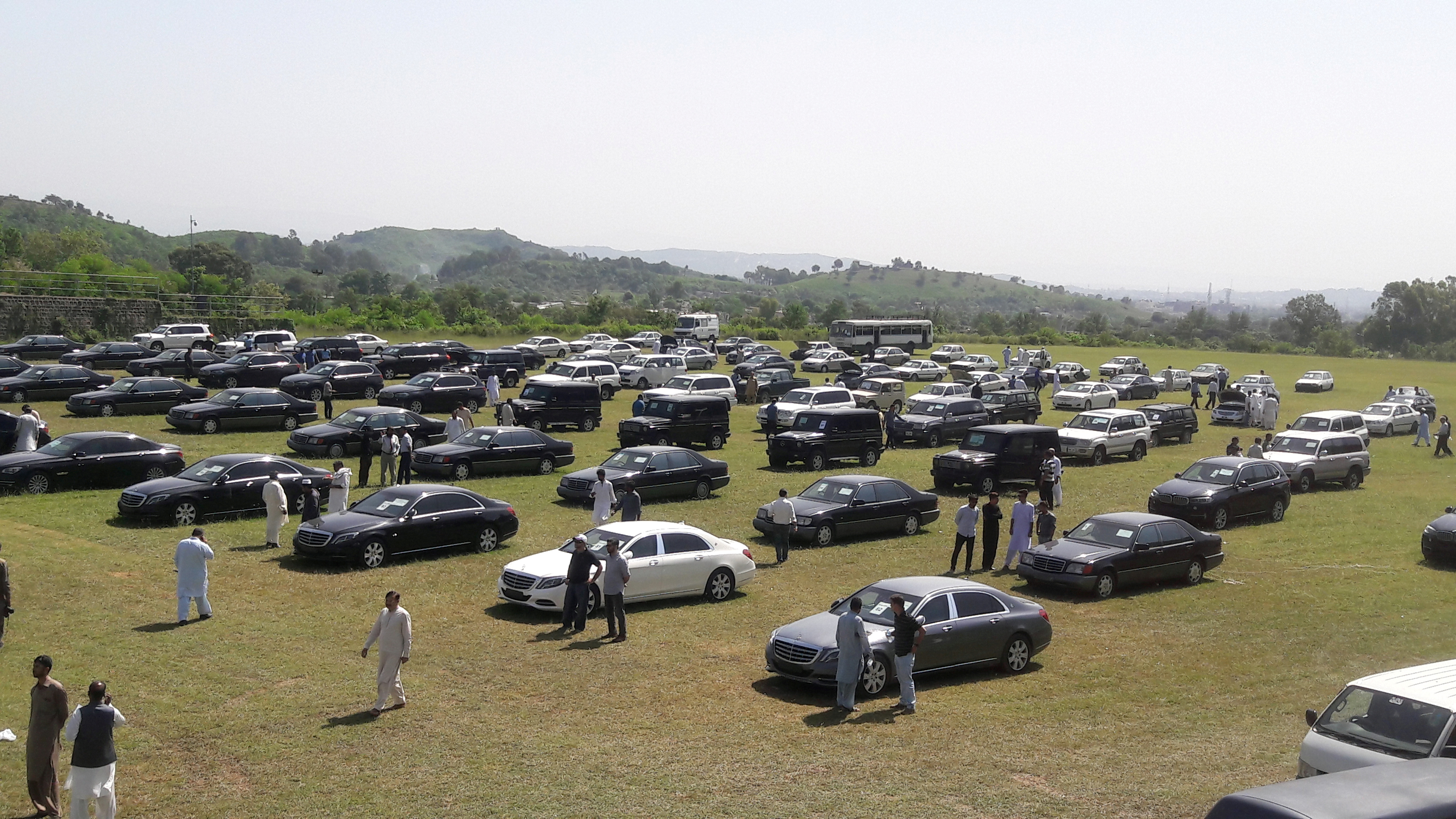 People visit an auction of government owned used cars at the premises of Prime Minister House in Islamabad, Pakistan on Sept. 17, 2018.