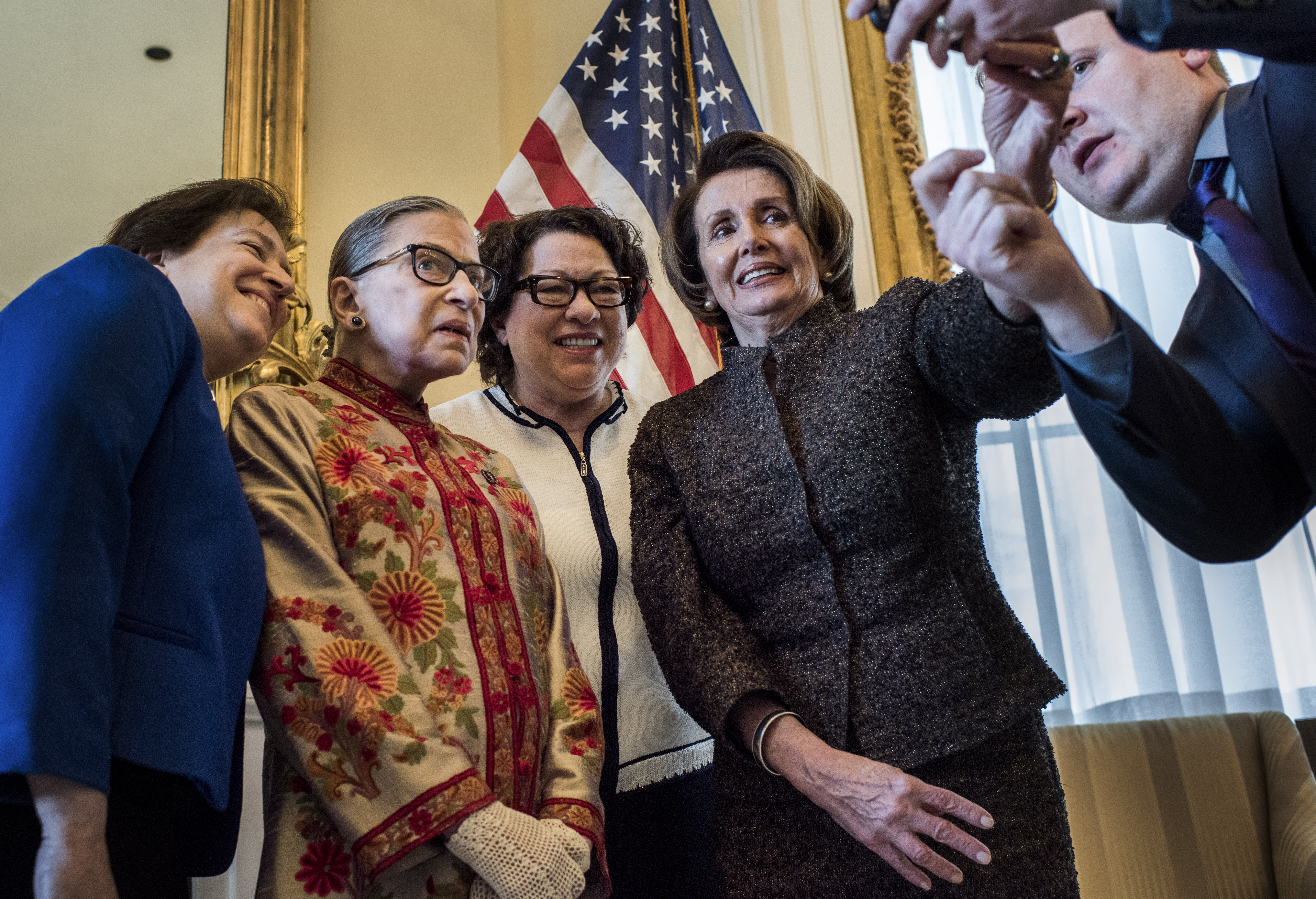 Assisted by staff Drew Hammill, Democratic Leader Nancy Pelosi takes a selfie with Associate Justice of the U.S. Supreme Court Elena Kagan, Associate Justice of the U.S. Supreme Court Ruth Bader Ginsburg, and Associate Justice of the U.S. Supreme Court Sonia Sotomayor at the US Capitol before a Womens History Month Reception Honoring the Women Justices of the U.S. Supreme Court,