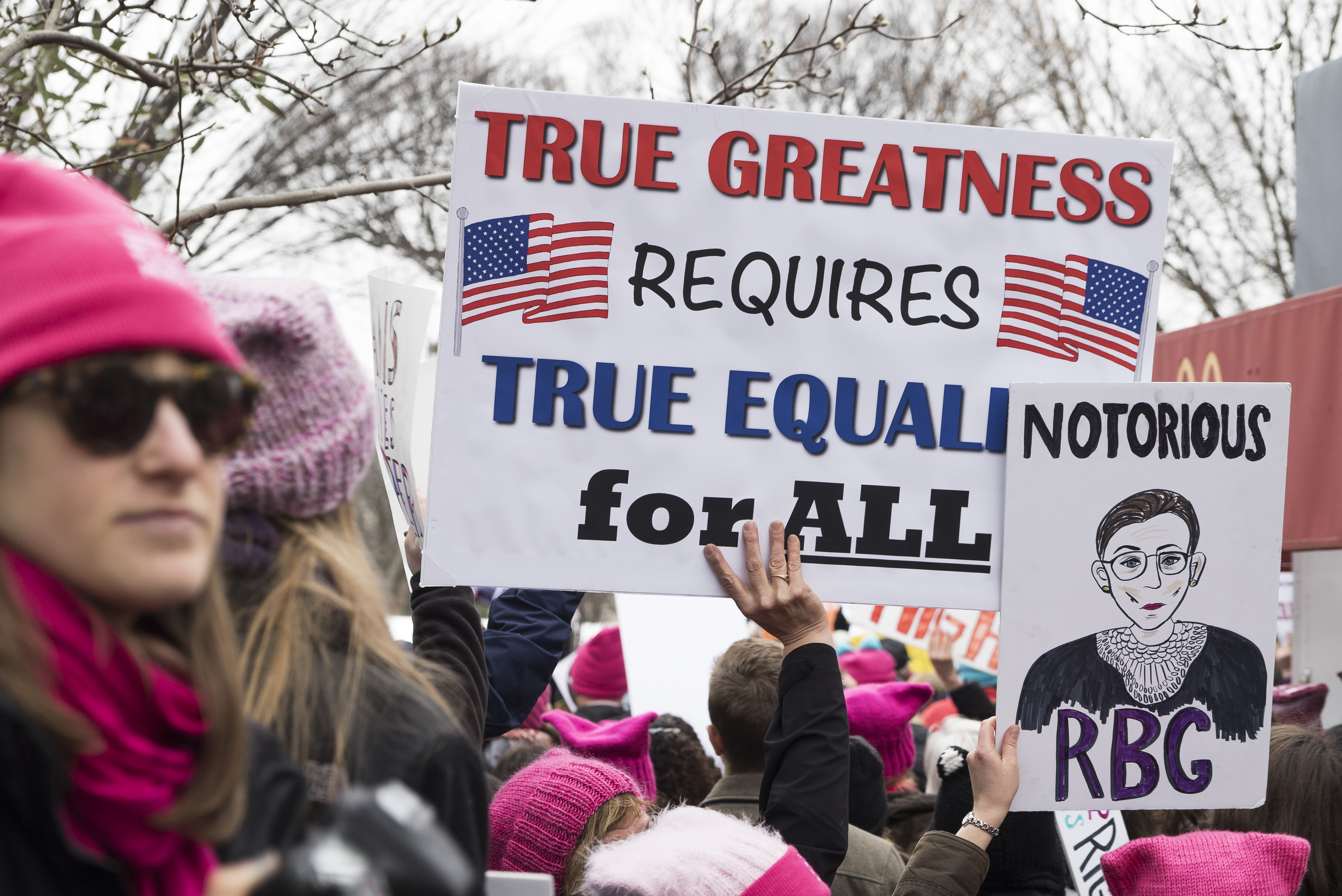 View of demonstrators, many with signs, during the Women's March on Washington, Washington DC, January 21, 2017. One sign features an illustration of US Supreme Court Justice Ruth Bader Ginsburg and reads 'Notorious RBG'. (Photo by Barbara Alper/Getty Images)