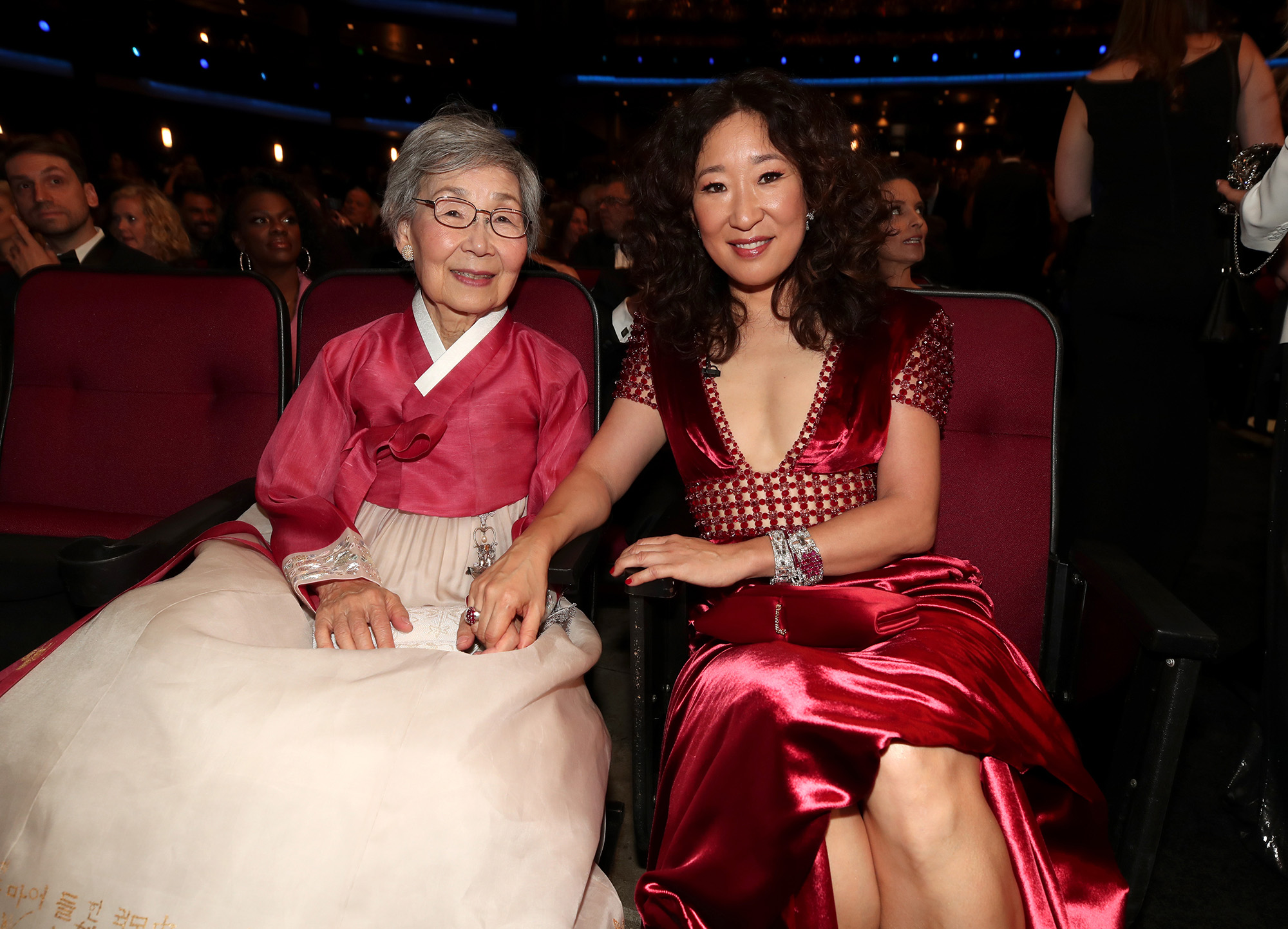 LOS ANGELES, CA - SEPTEMBER 17:  70th ANNUAL PRIMETIME EMMY AWARDS -- Pictured: (l-r) Jeon Young-nam and Sandra Oh arrives to the 70th Annual Primetime Emmy Awards held at the Microsoft Theater on September 17, 2018.  NUP_184221  (Photo by Christopher Polk/NBC/NBCU Photo Bank via Getty Images)