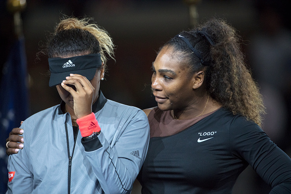Serena Williams of the United States embraces Naomi Osaka of Japan as she cries at the presentations after the controversial Women's Singles Final at the 2018 US Open Tennis Tournament on September 8th, 2018 in Flushing, Queens, New York City.