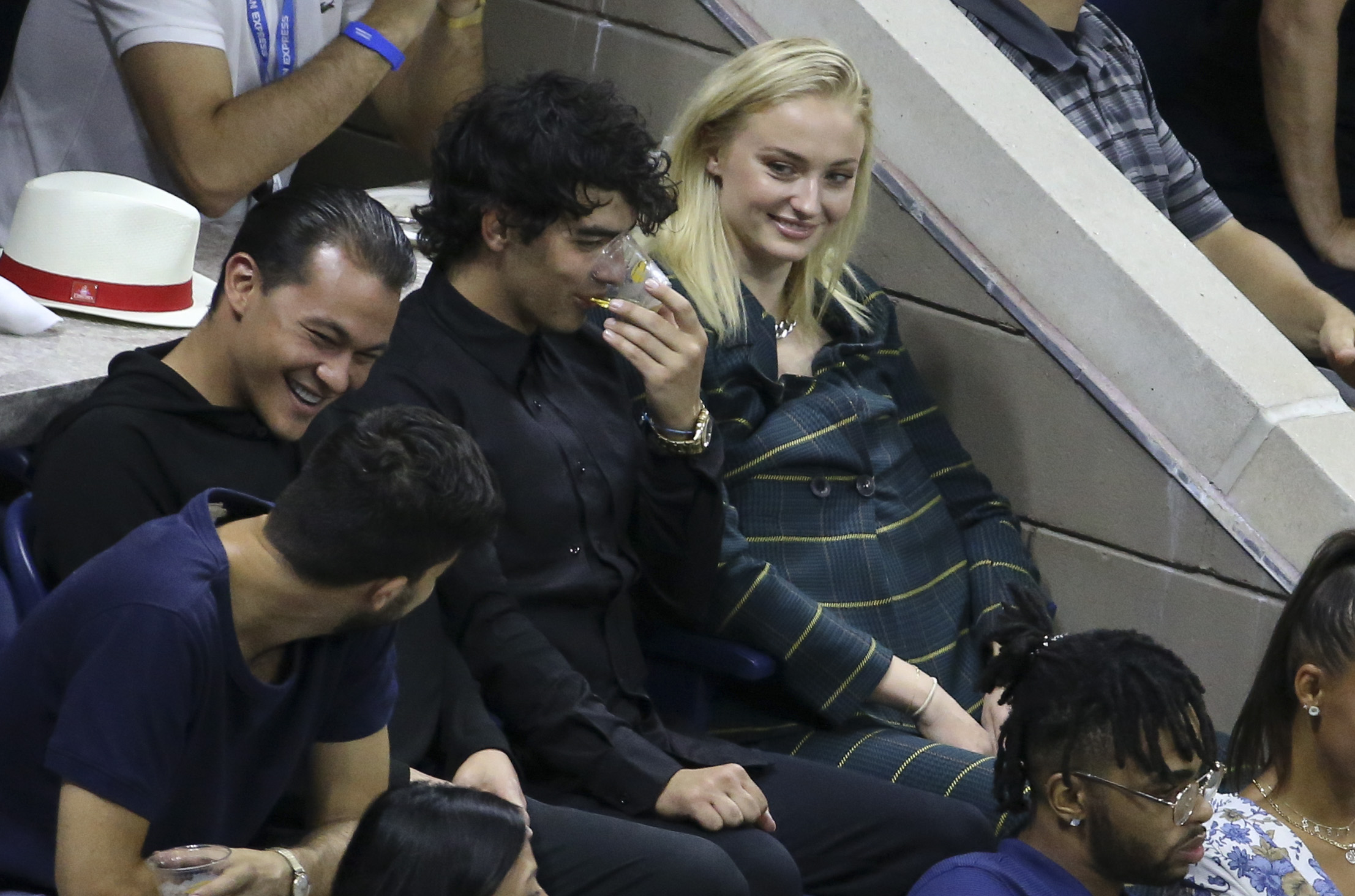 Joe Jonas and girlfriend Sophie Turner have a laugh at the US Open on Arthur Ashe stadium at the USTA Billie Jean King National Tennis Center on August 31, 2018 in Flushing Meadows, Queens, New York City. (Photo by Jean Catuffe/GC Images)