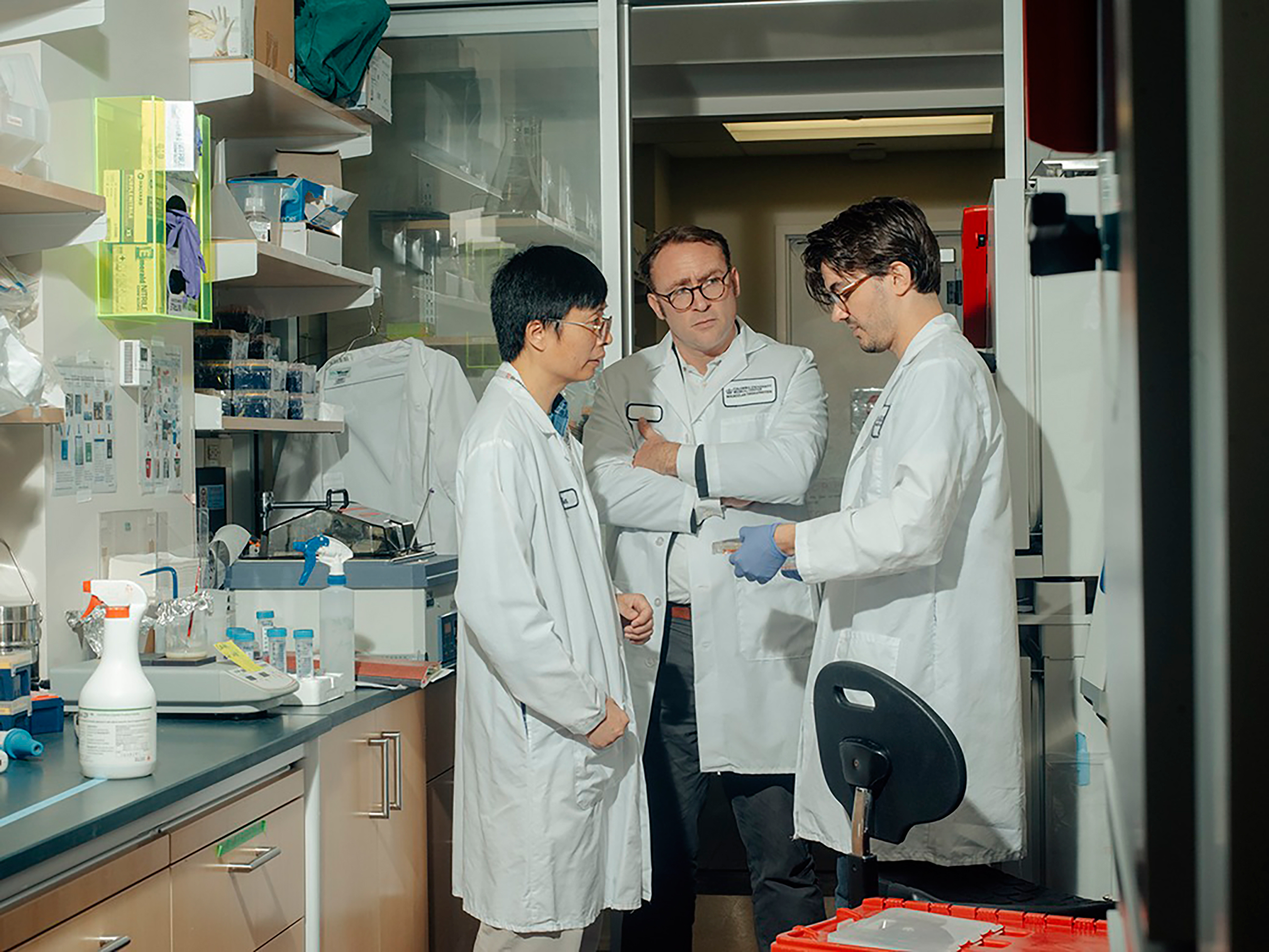 ^ Neurobiologist Bin Xu and Drs. Markx and de Jong, from left, inspect the mini-brains on Sept. 4