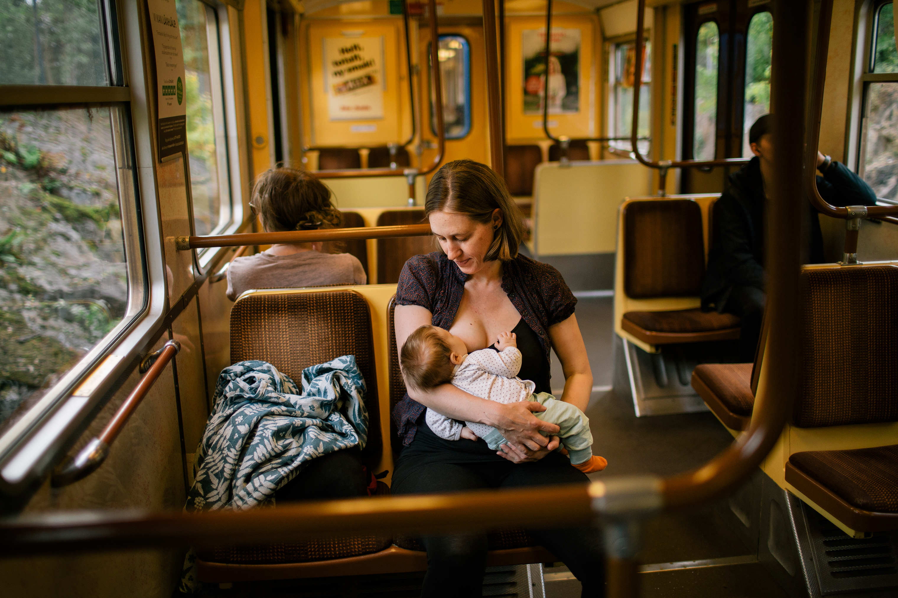 Ulrika Casselbrant, 38, breastfeeds her 8 week old child, Vera, on a commuter train in Stockholm on Aug. 19, 2018.