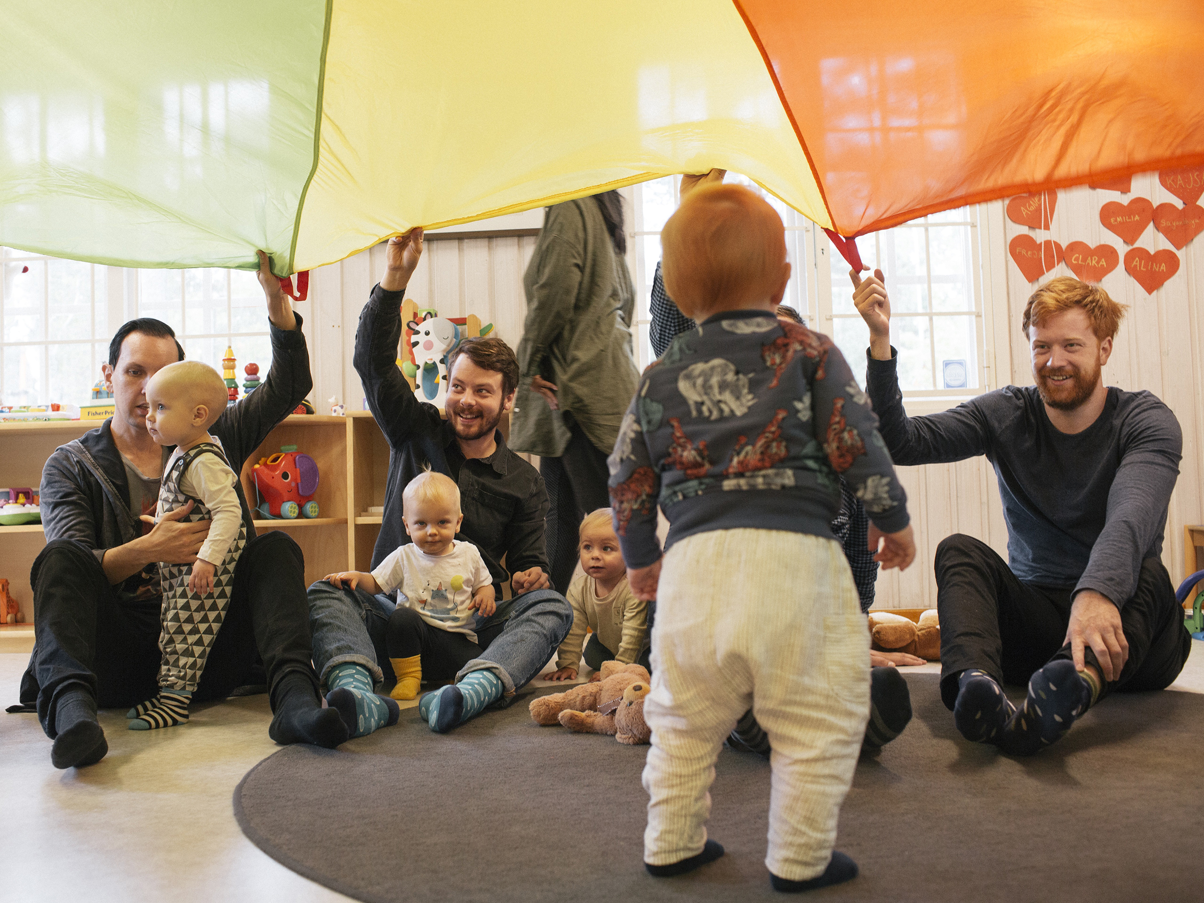 Fathers and children in Stockholm play at a center where parents on leave gather to socialize