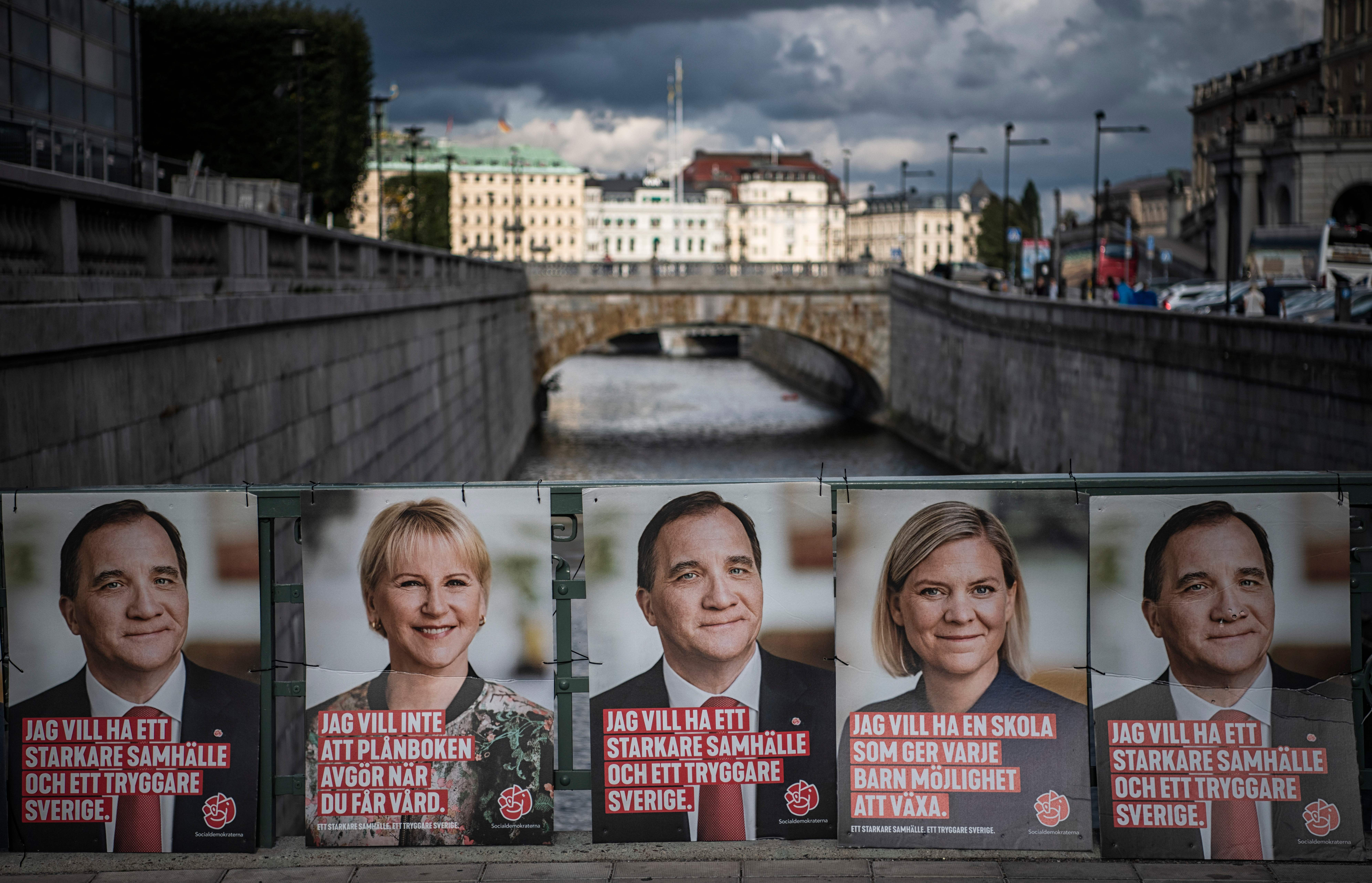 Election posters of the leader of the Social Democrats and Swedish Prime Minister Stefan Loefven, Swedish Minister for Finance Magdalena Andersson (2nd R) and Sweden's Foreign Minister Margot Wallstrom (2nd L) are pictured on September 1, 2018 in Stockholm.