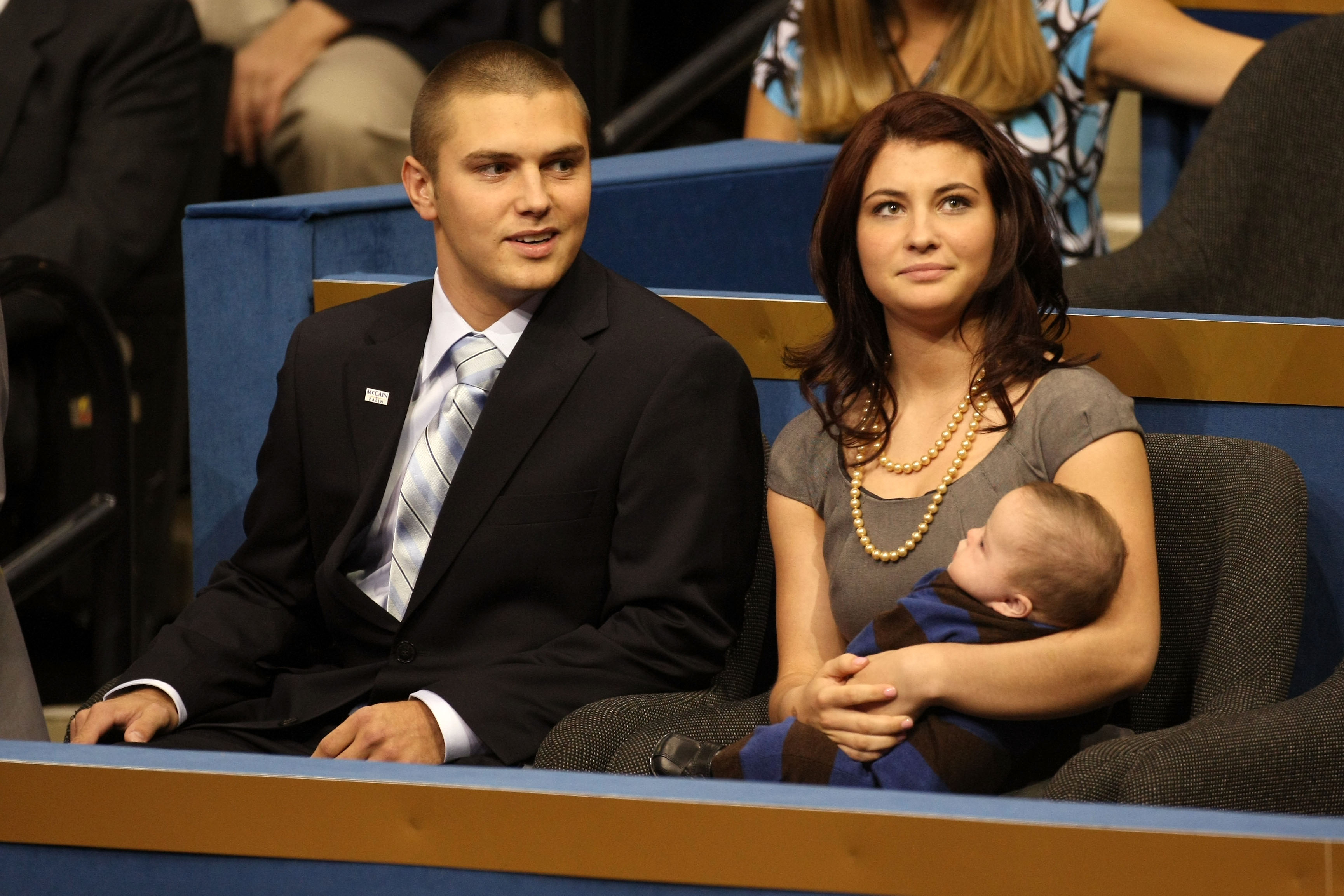 Track Palin sits with Willow Palin holding Trig Palin at the Republican National Convention (RNC) on September 3, 2008 in St. Paul, Minnesota.