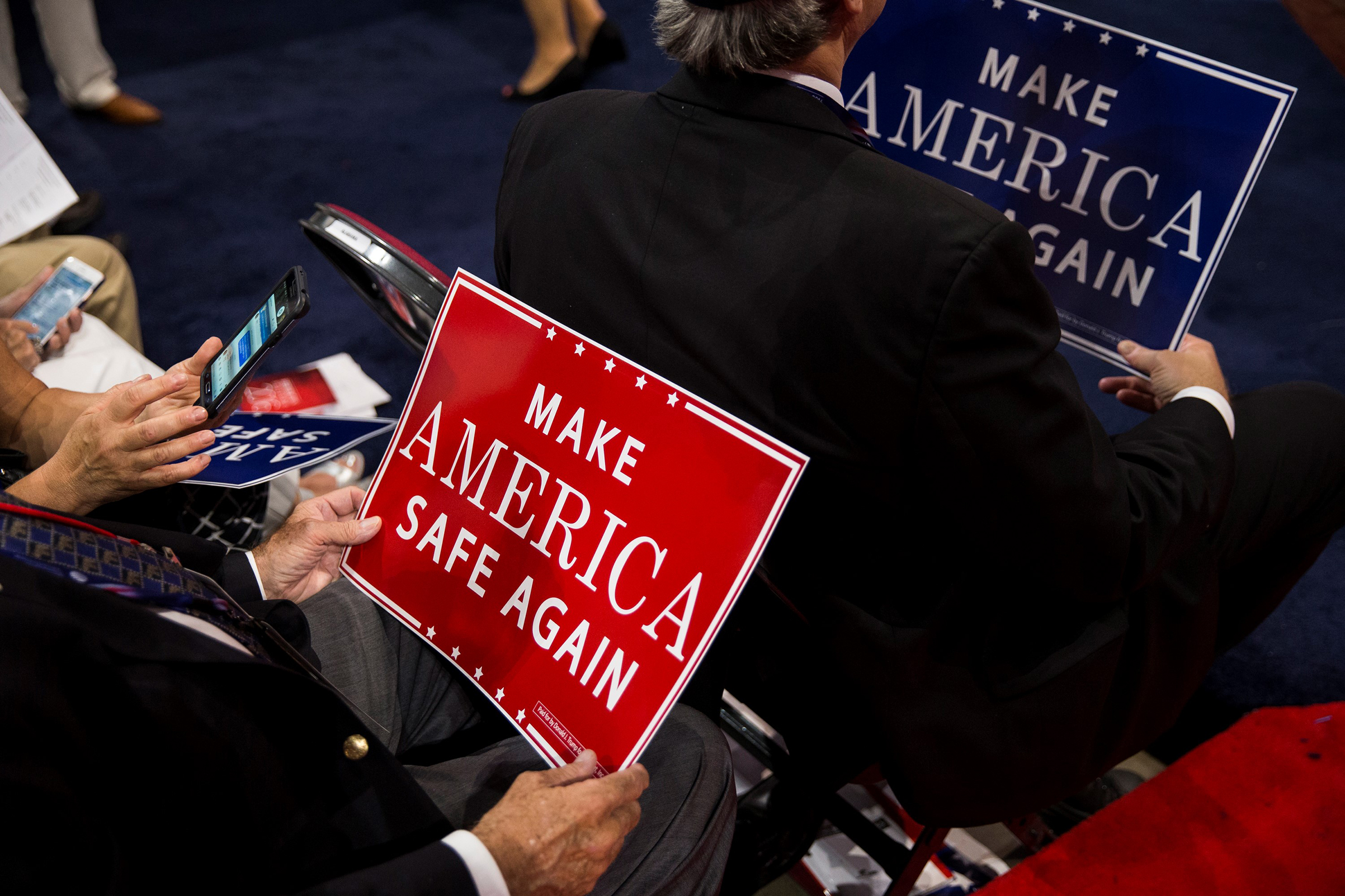 Delegates hold signs that say  Make America Safe Again , the new GOP slogan, during the 2016 Republican National Convention in Cleveland, Ohio, on July 18, 2016.