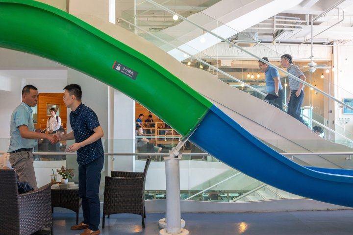 Meetings take place in the tropical-themed public areas of a Xiaomi office in Beijing..