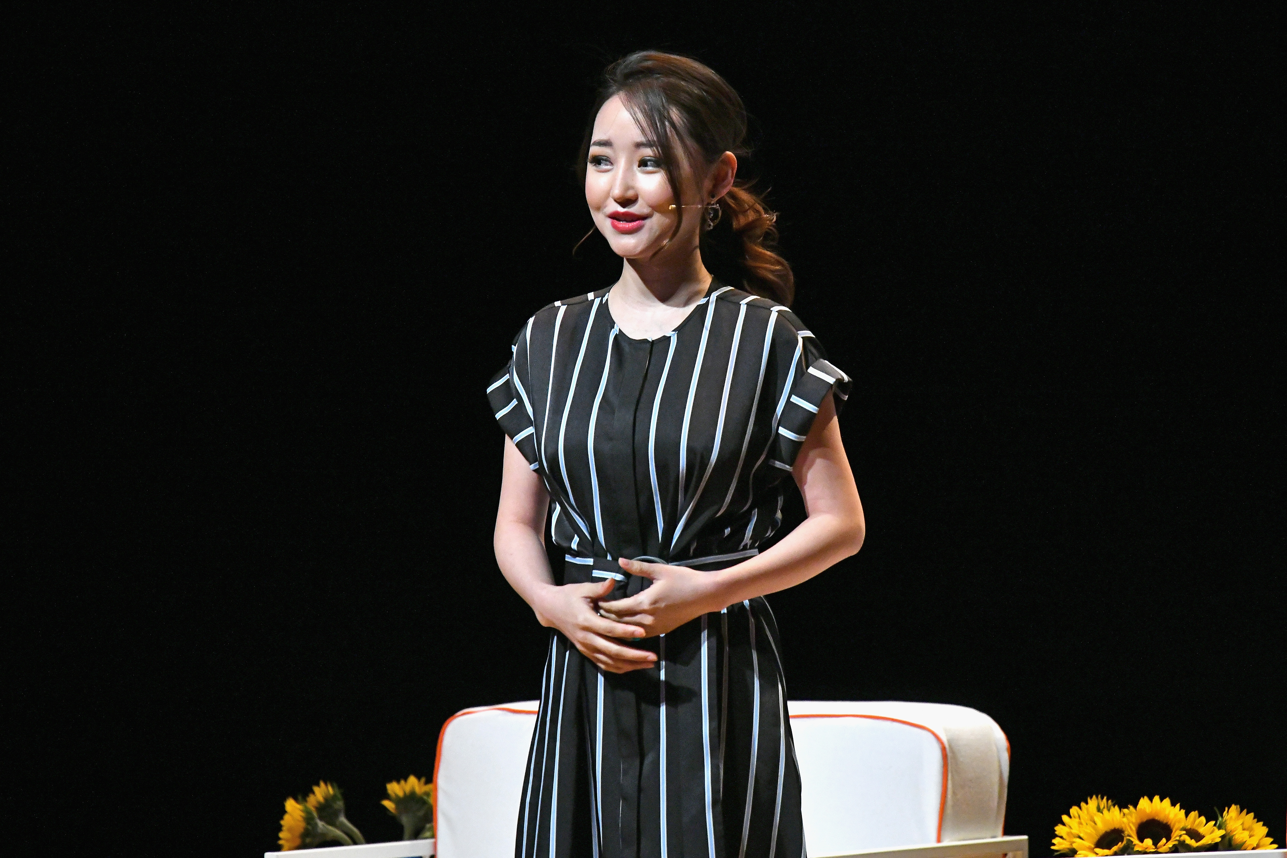 Activist Yeonmi Park speaks onstage during The Tory Burch Foundation 2018 Embrace Ambition Summit at Alice Tully Hall on April 24, 2018 in New York City.