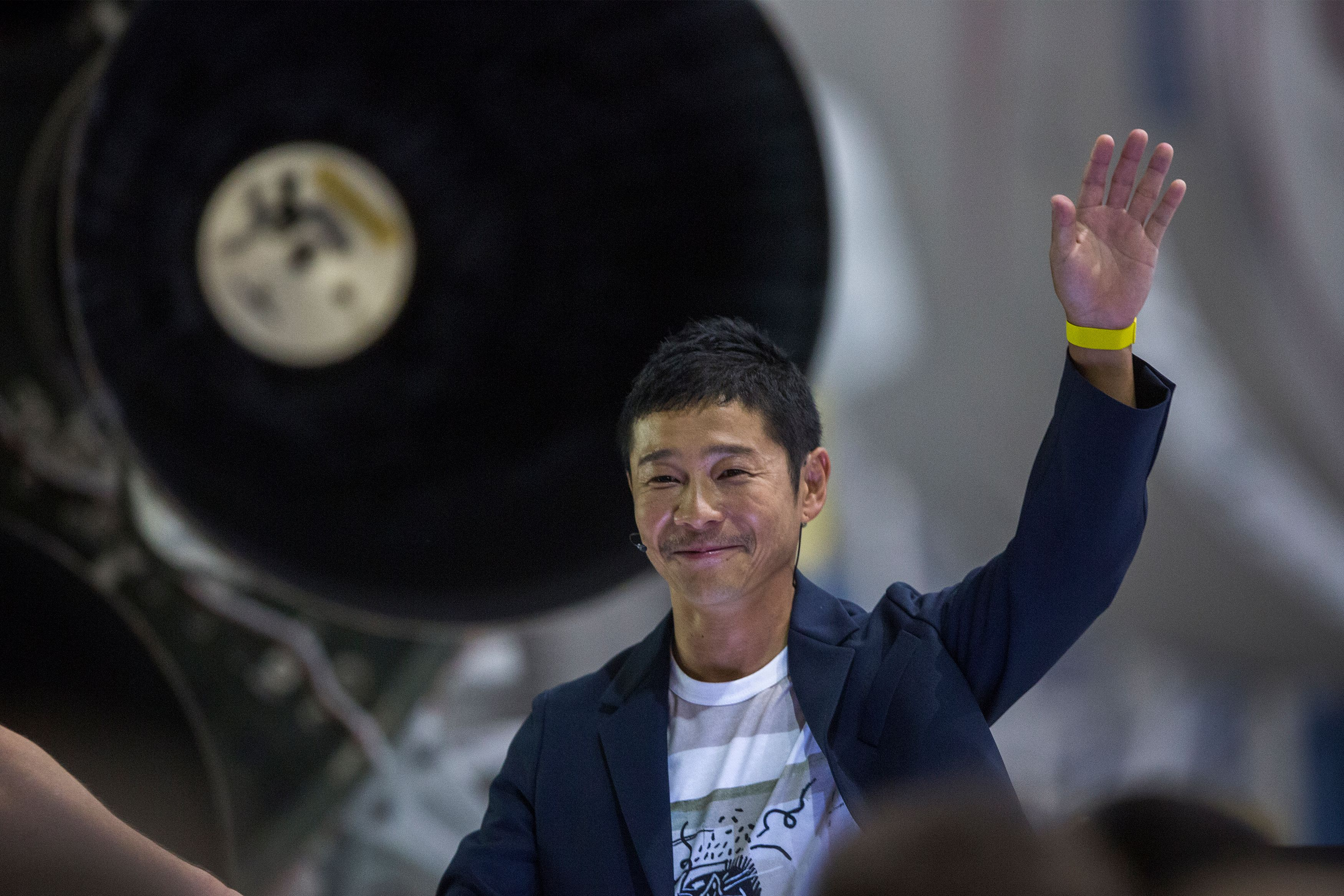 Japanese billionaire Yusaku Maezawa speaks near a Falcon 9 rocket during the announcement by Elon Musk to be the first private passenger who will fly around the Moon aboard the SpaceX BFR launch vehicle, at the SpaceX headquarters and rocket factory on September 17, 2018 in Hawthorne, California.