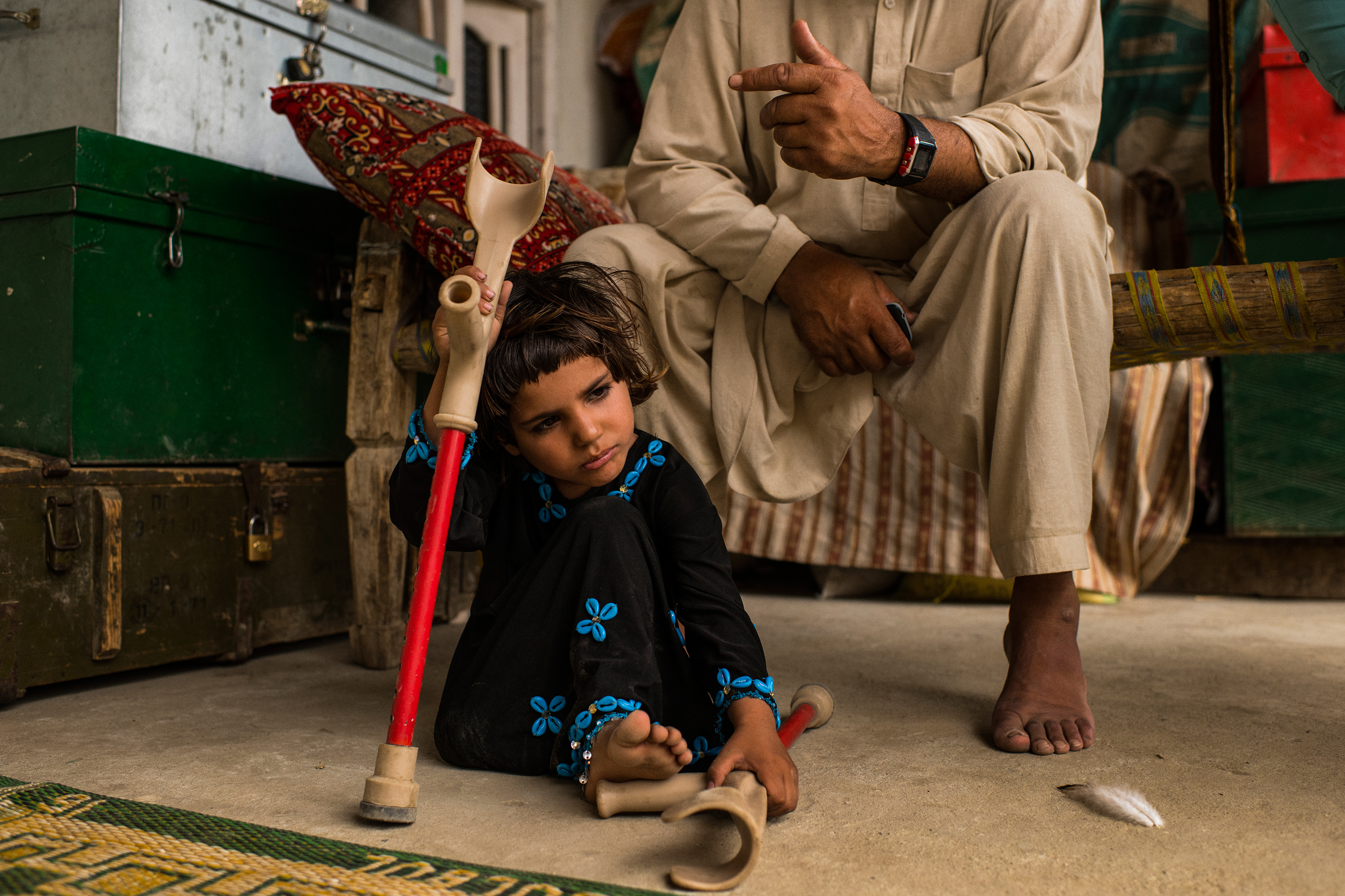 Marwa with her crutches in July. Her mother and twin sister were killed in the blast that led to the loss of part of her right leg.