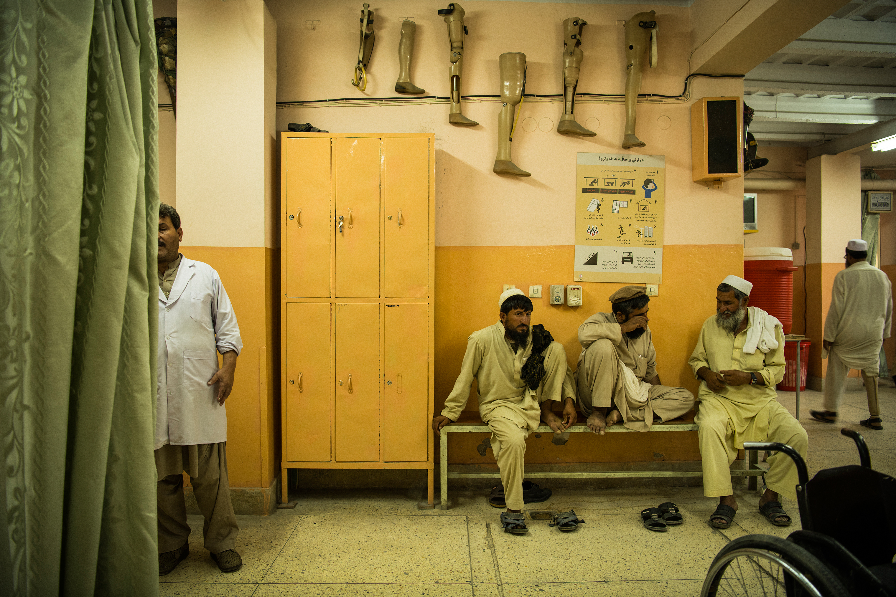 Hamisha Gul, right, at the orthopedic center in Jalalabad on June 27. In the center is Mohammad Hanif, Aman's father.