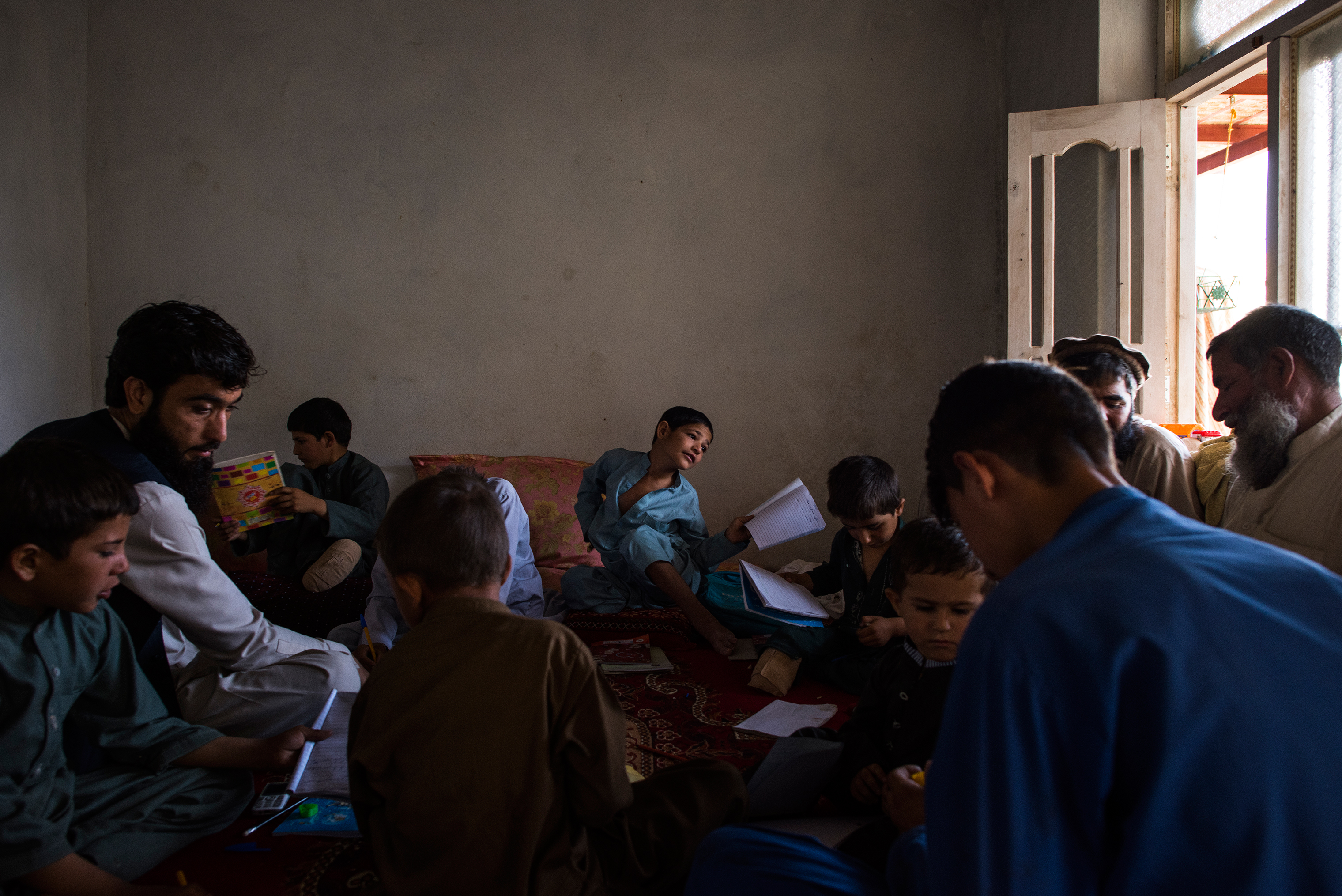 During the children's recovery, they continued to study with a teacher provided by a small charity, Enabled Children. This lesson, in June, was conducted at a neighbor's home as their own was undergoing construction work.