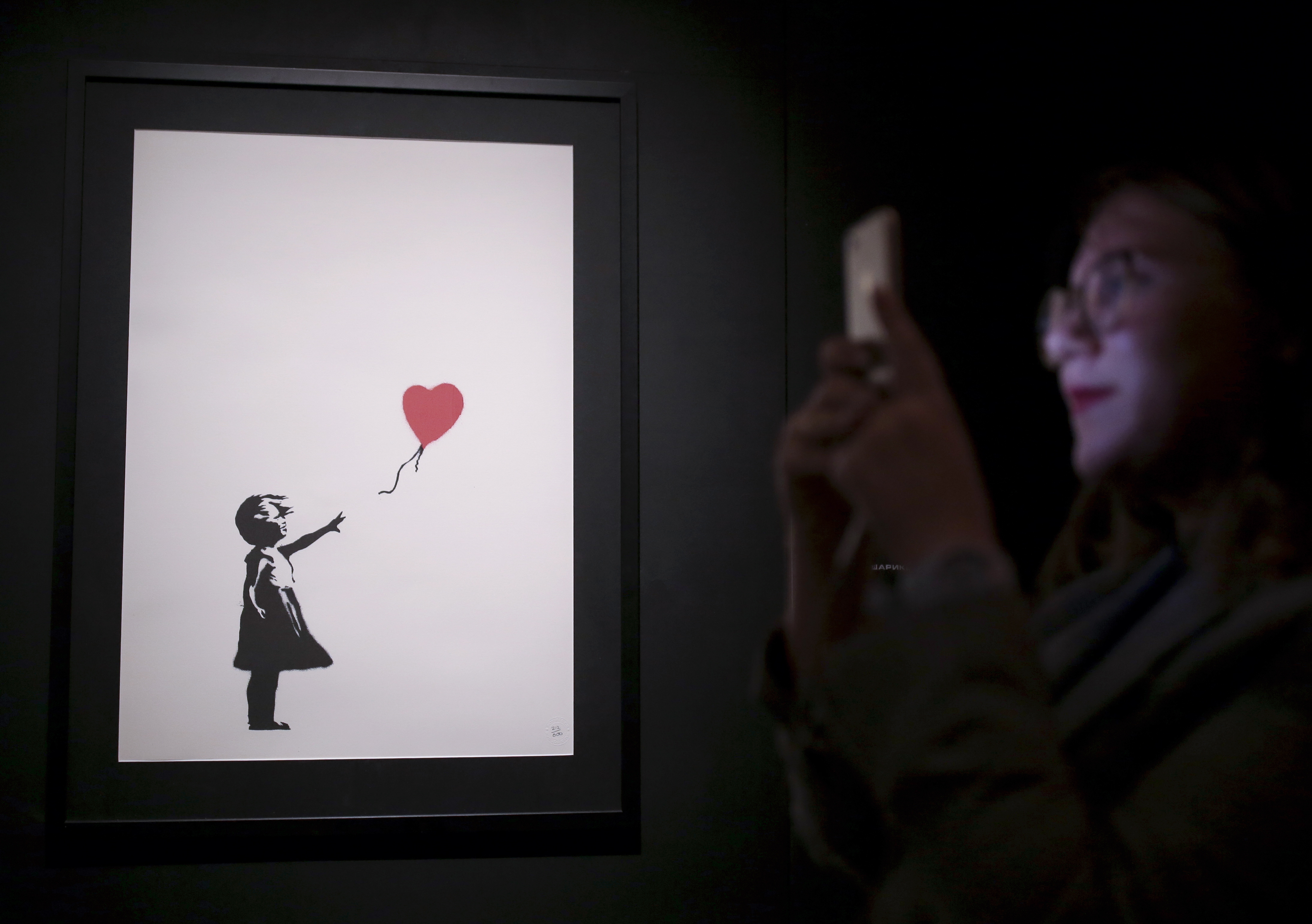 A Balloon Girl mural on display at an exhibition of works by England-based street artist Banksy opening at St Petersburg's Manege Central Exhibition Hall. Anton Vaganov/TASS
