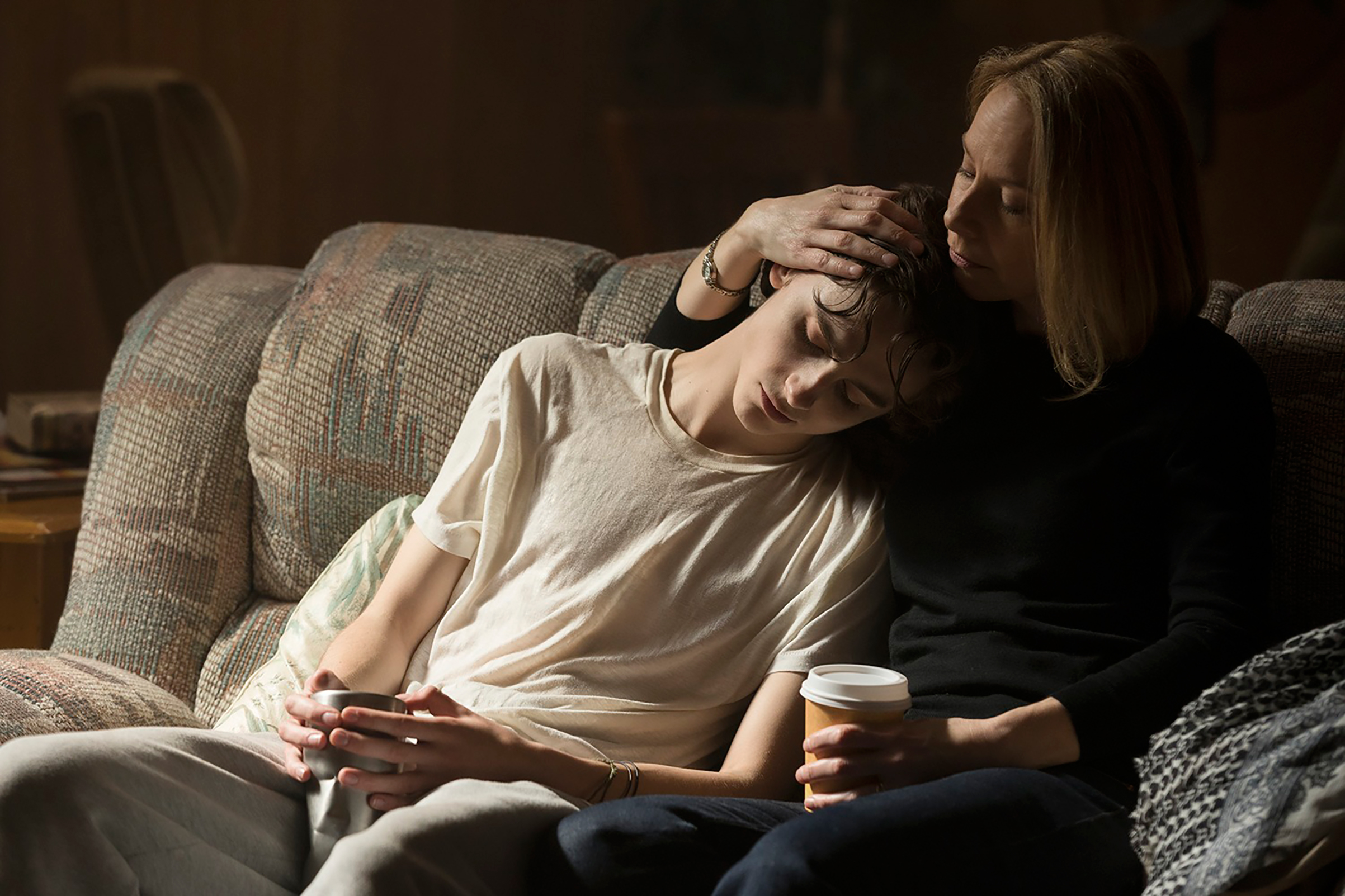 Nic (Timothée Chalamet) is consoled by his mother (Amy Ryan)