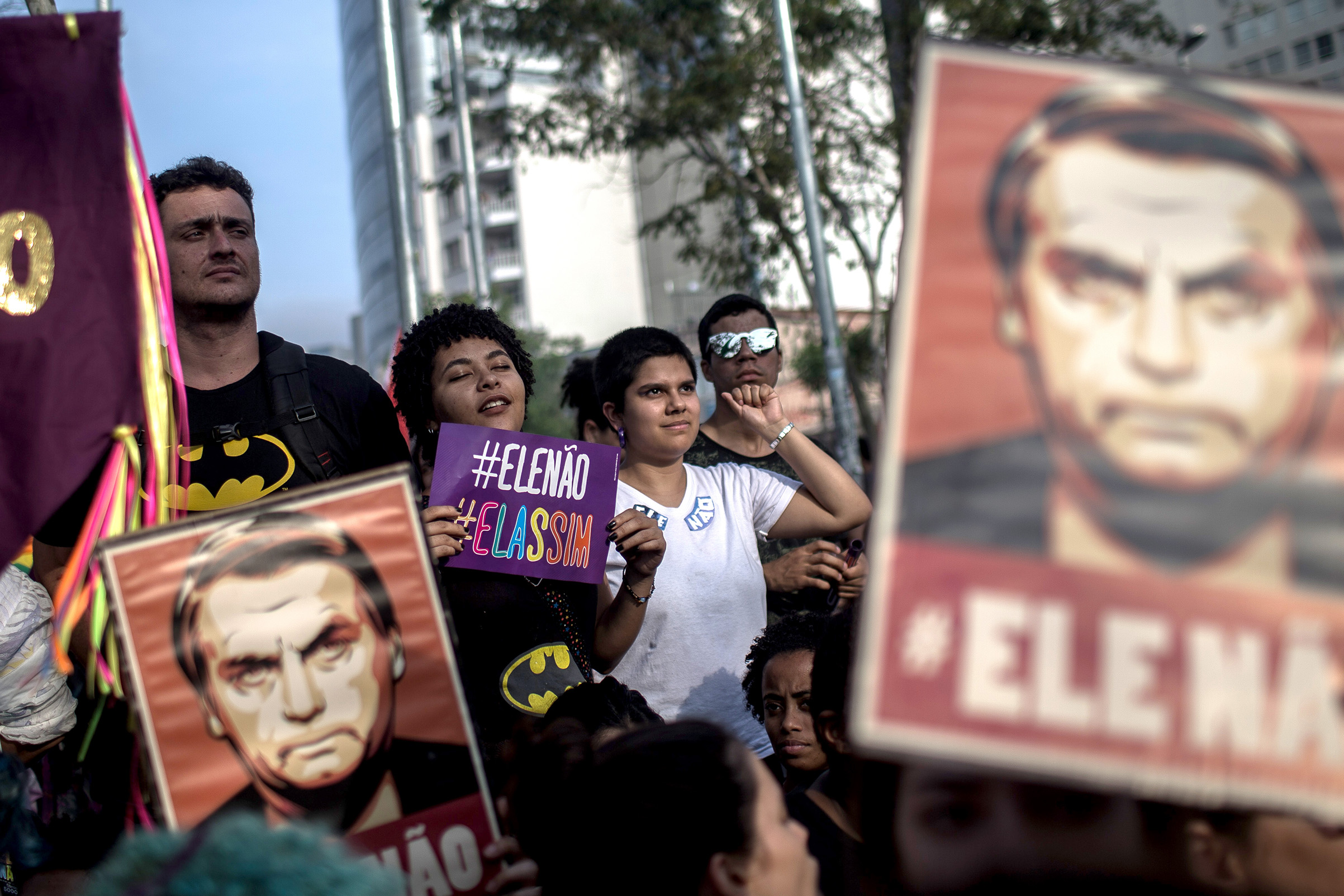 Protesters carry posters against the far-right's presidential candidate Jair Bolsonaro in Sao Paulo, Brazil on Sept. 29, 2018.