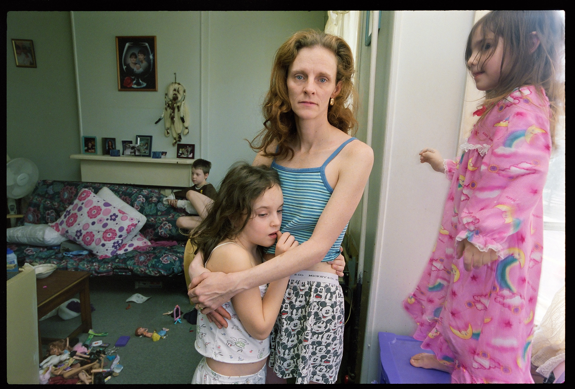 Lori Smith and her son, Darien and her daughters Megan and Katie all moved into an apartment in Debs house after they were evicted in 2006,  says Kenneally.